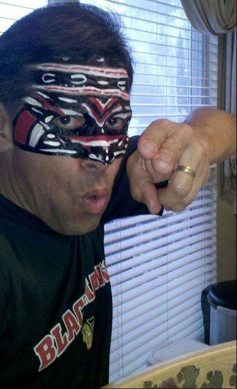 """My superstitious belief is ""If the Blackhawks win the opening game faceoff, they win the game."" says Gene Diaz in South Elgin, who paints his face during the quest for the cup."
