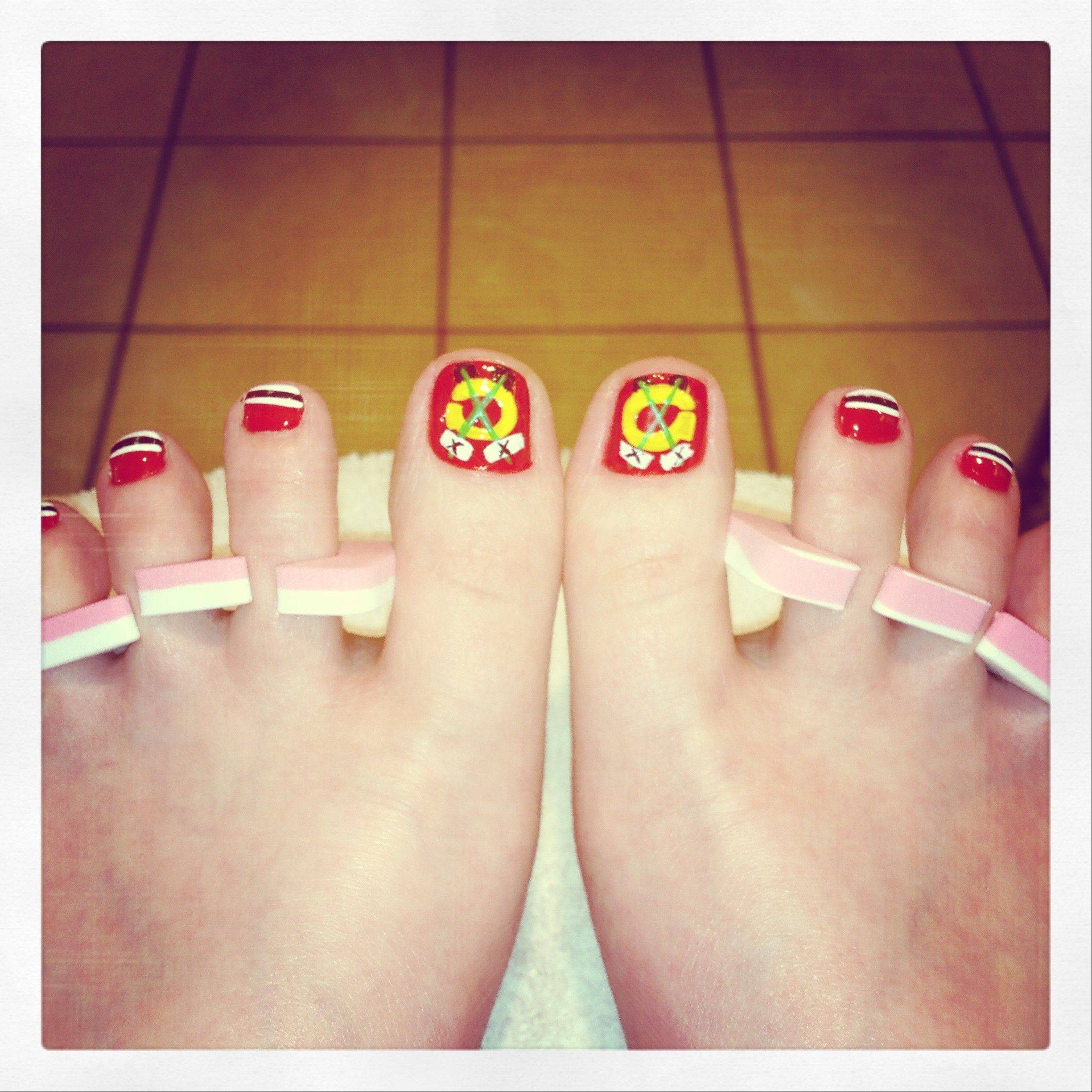 Stacey of Palatine gets her toes done in honor of the Blackhawks.
