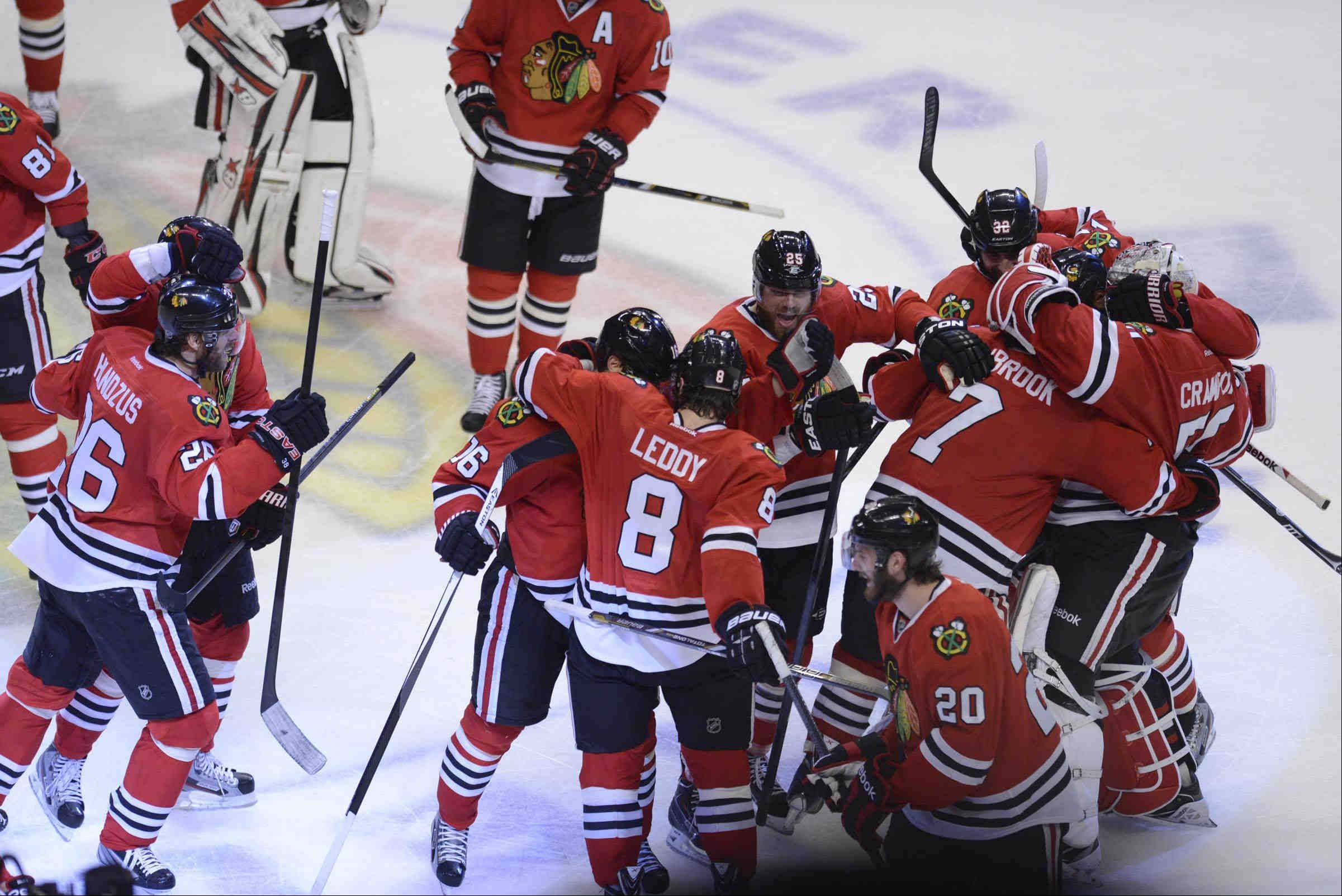 The Chicago Blackhawks celebrate winning the NHL Western Conference Championship at the United Center in Chicago.