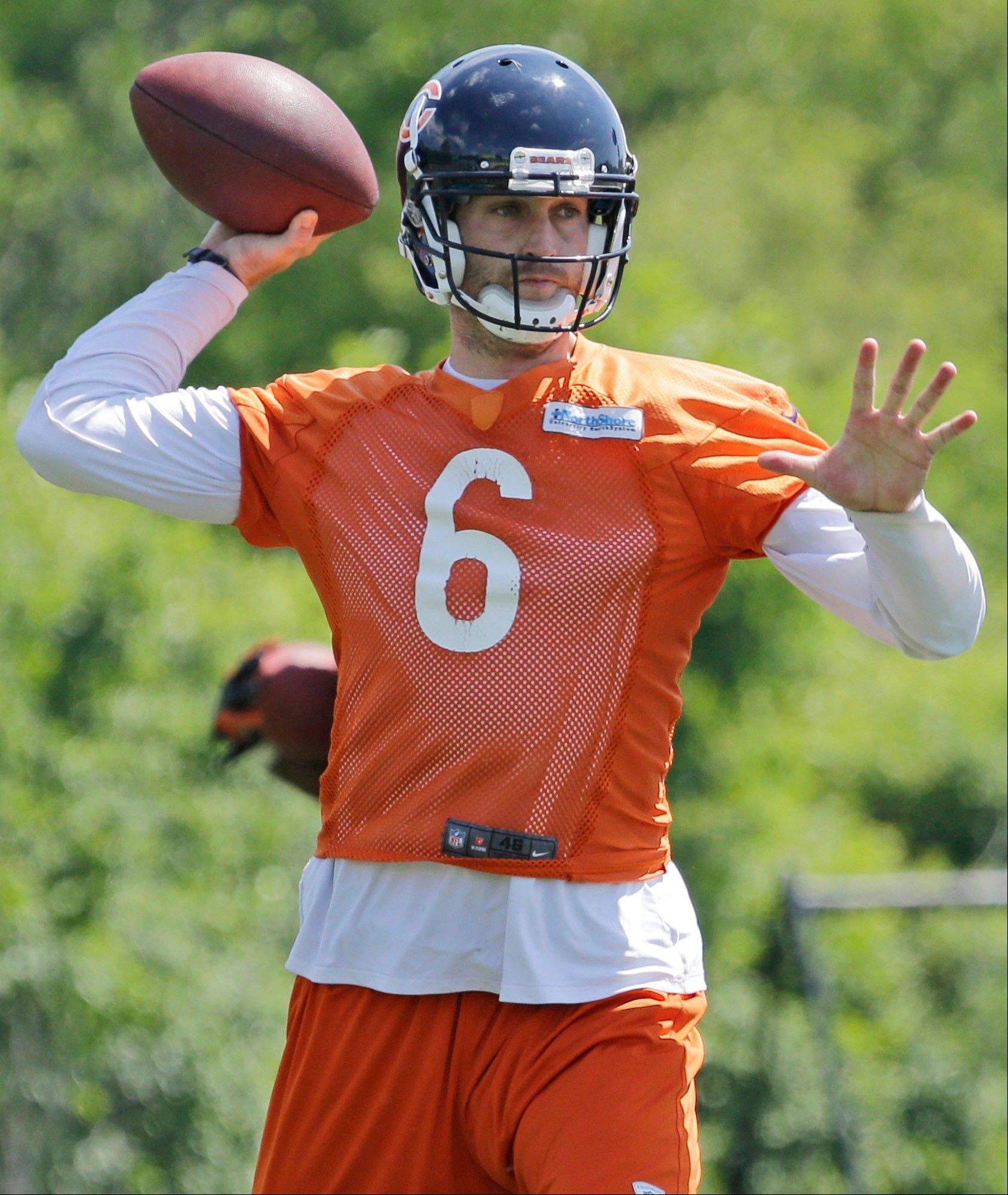 Quarterback Jay Cutler throws during the Bears' mandatory minicamp Tuesday at Halas Hall in Lake Forest.