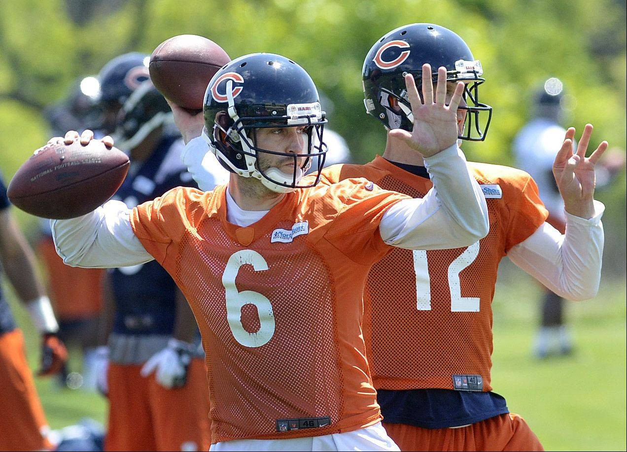 Quarterbacks Jay Cutler and Josh McCown throw in tandem at Bears minicamp Tuesday at Halas Hall in Lake Forest.
