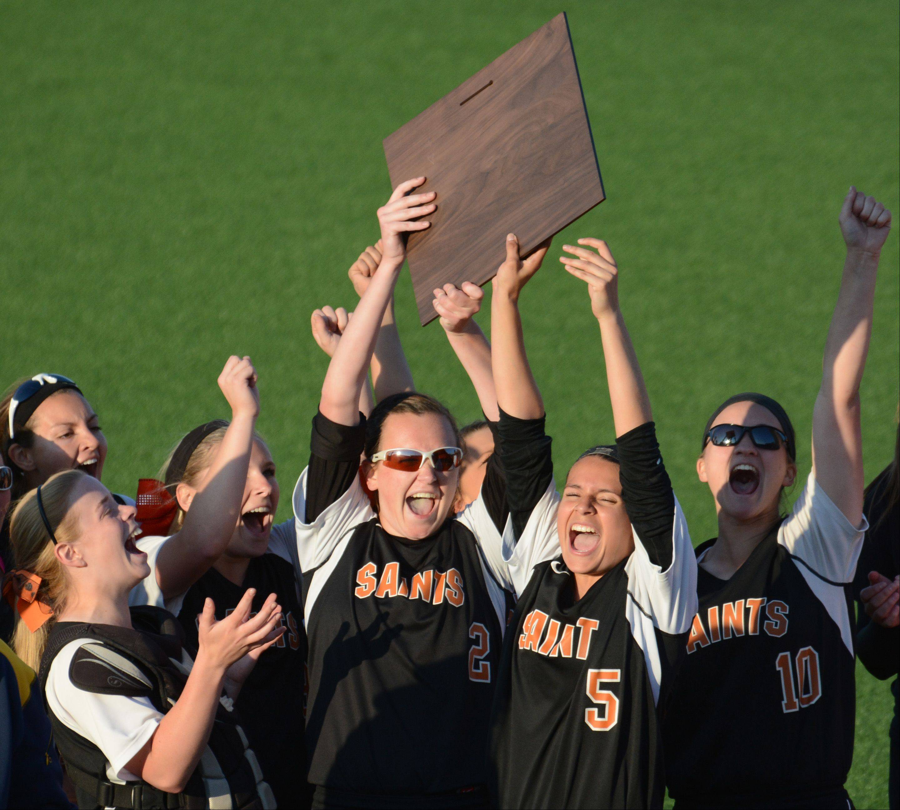 St. Charles East players celebrate after winning Monday's Class 4A supersectional softball game in Rosemont.