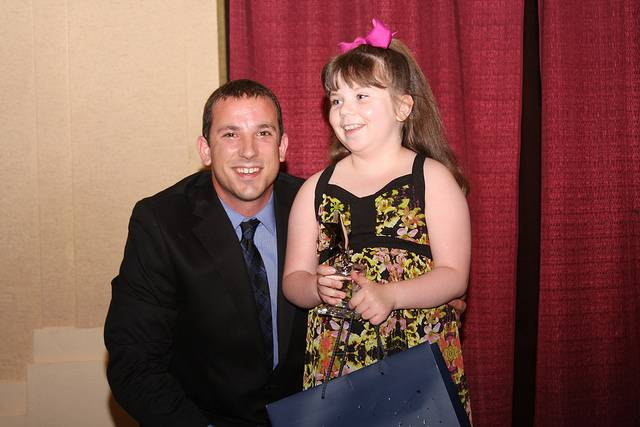 Jon Vidovic presents the Rising Star award to Mackenzie Annoreno of Itasca.
