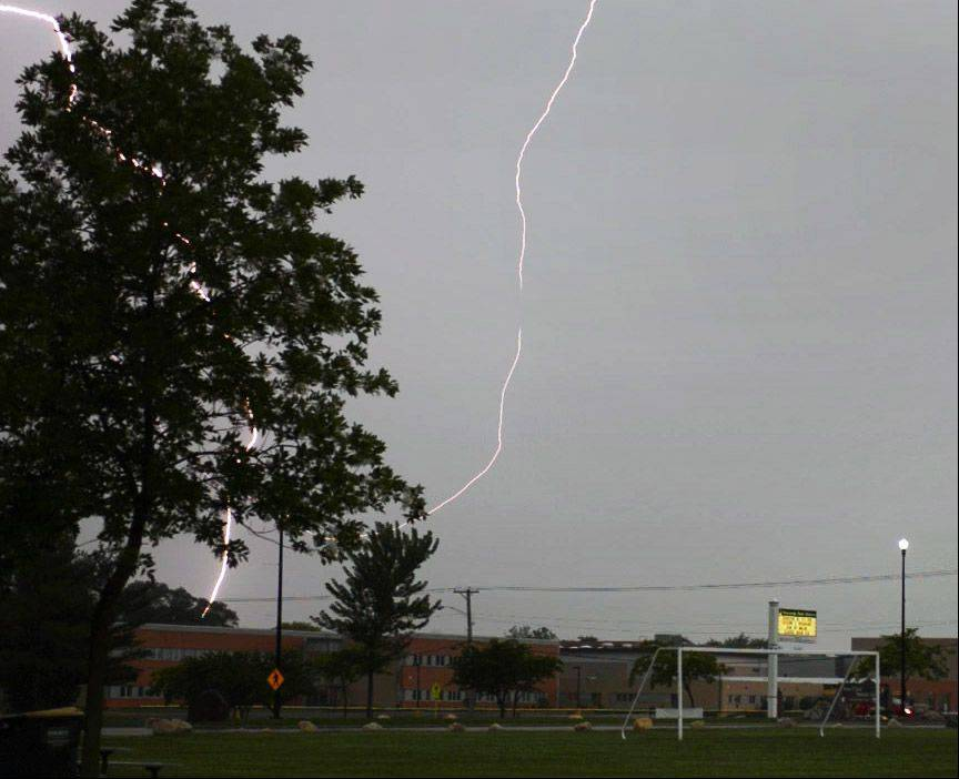 Lightning strikes near Wauconda High School Wednesday evening as storms roll into the Chicago area.
