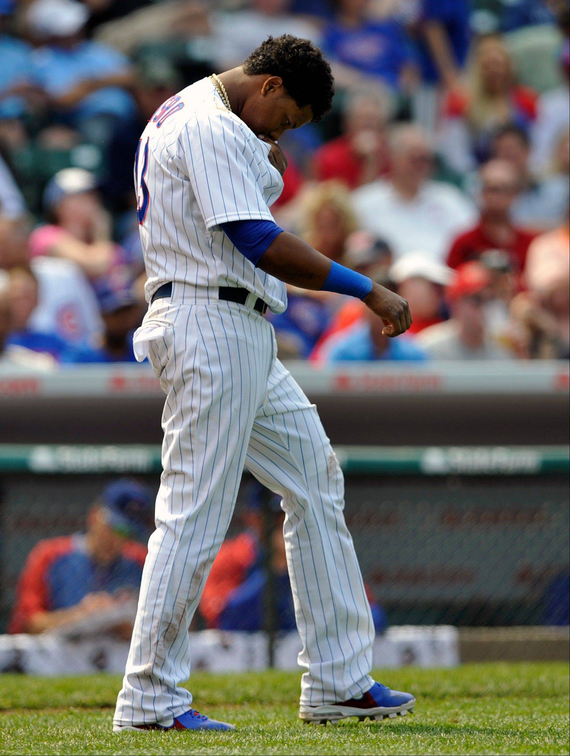 Chicago Cubs' Starlin Castro reacts after striking out against the Cincinnati Reds during the seventh inning of a baseball game on Wednesday, June 12, 2013, in Chicago. (AP Photo/Jim Prisching)