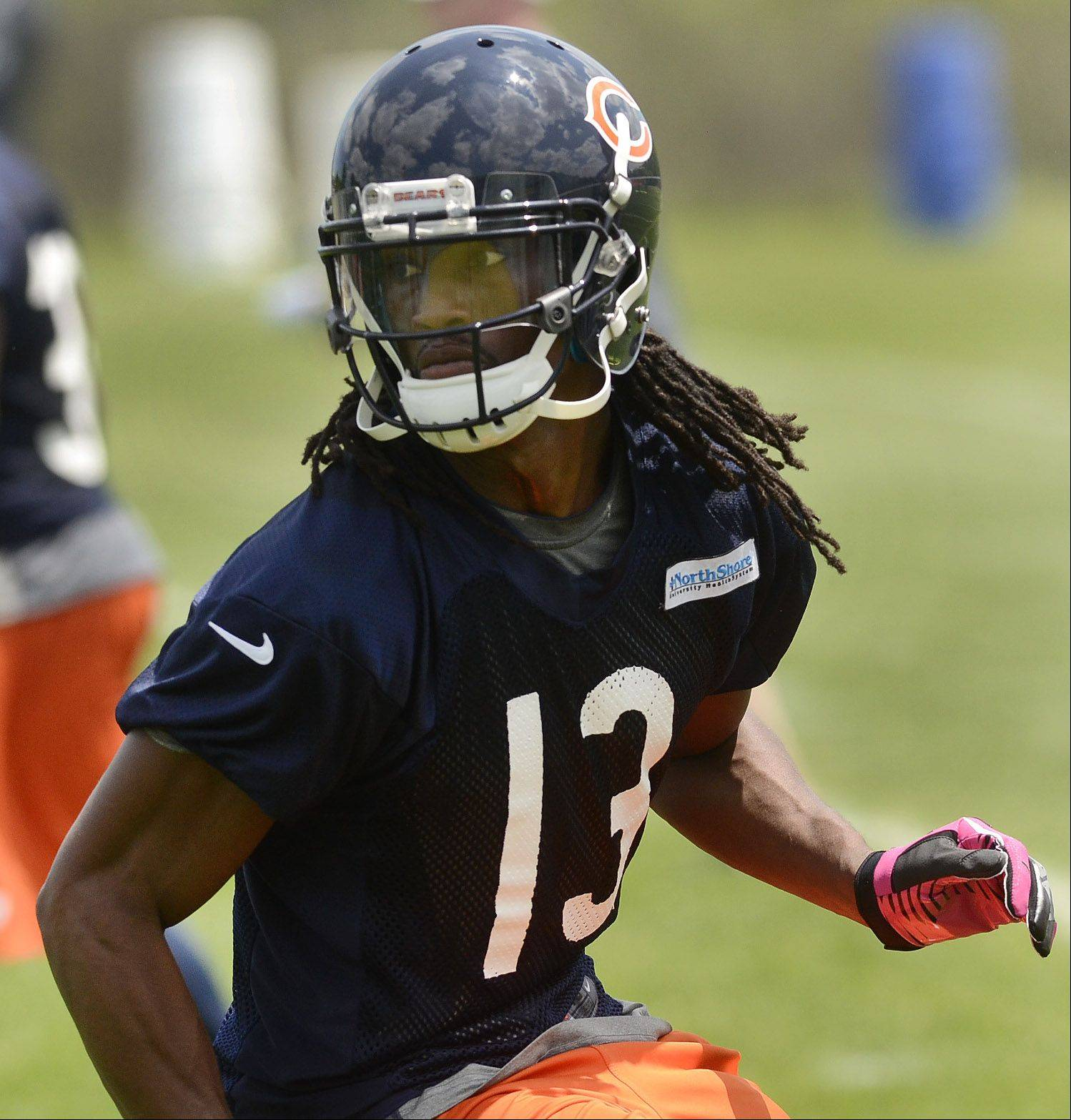 Newly re-acquired wideout Devin Aromashodu runs a pass route during Bears minicamp.