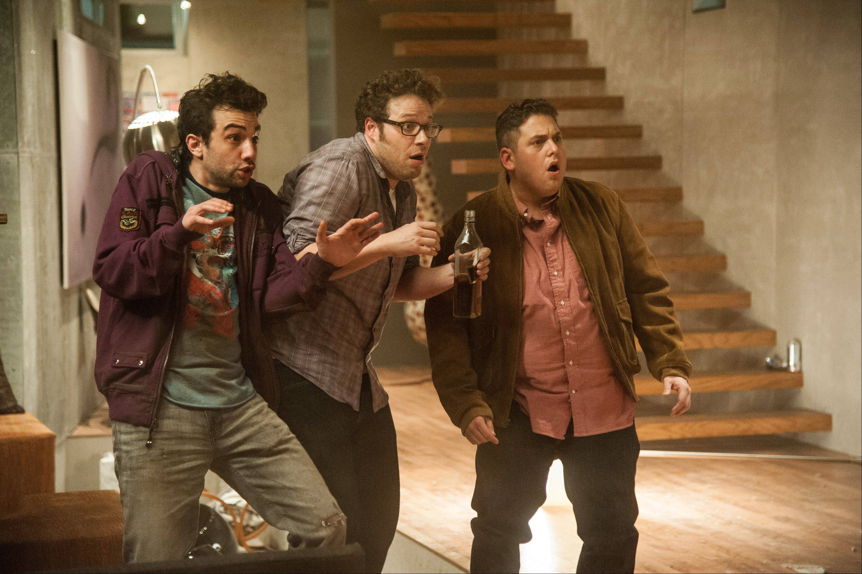 "Jay Baruchel, Seth Rogen and Jonah Hill freak out during Armageddon in the horror comedy ""This Is The End."""