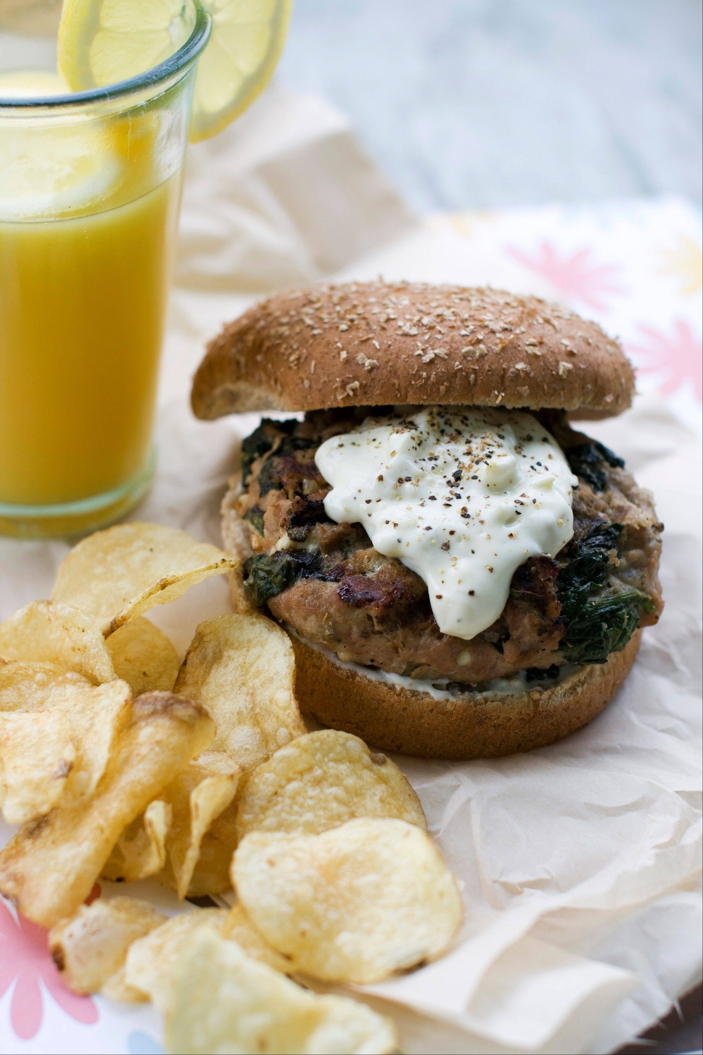 Sara Moulton blends spinach, oregano and feta into ground meat to give her turkey burgers a Greek flare.