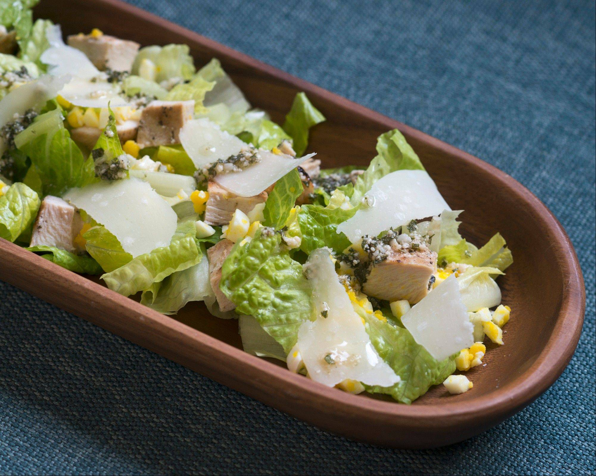 Marinated and grilled chicken makes a simple chicken Caesar salad spectacular.