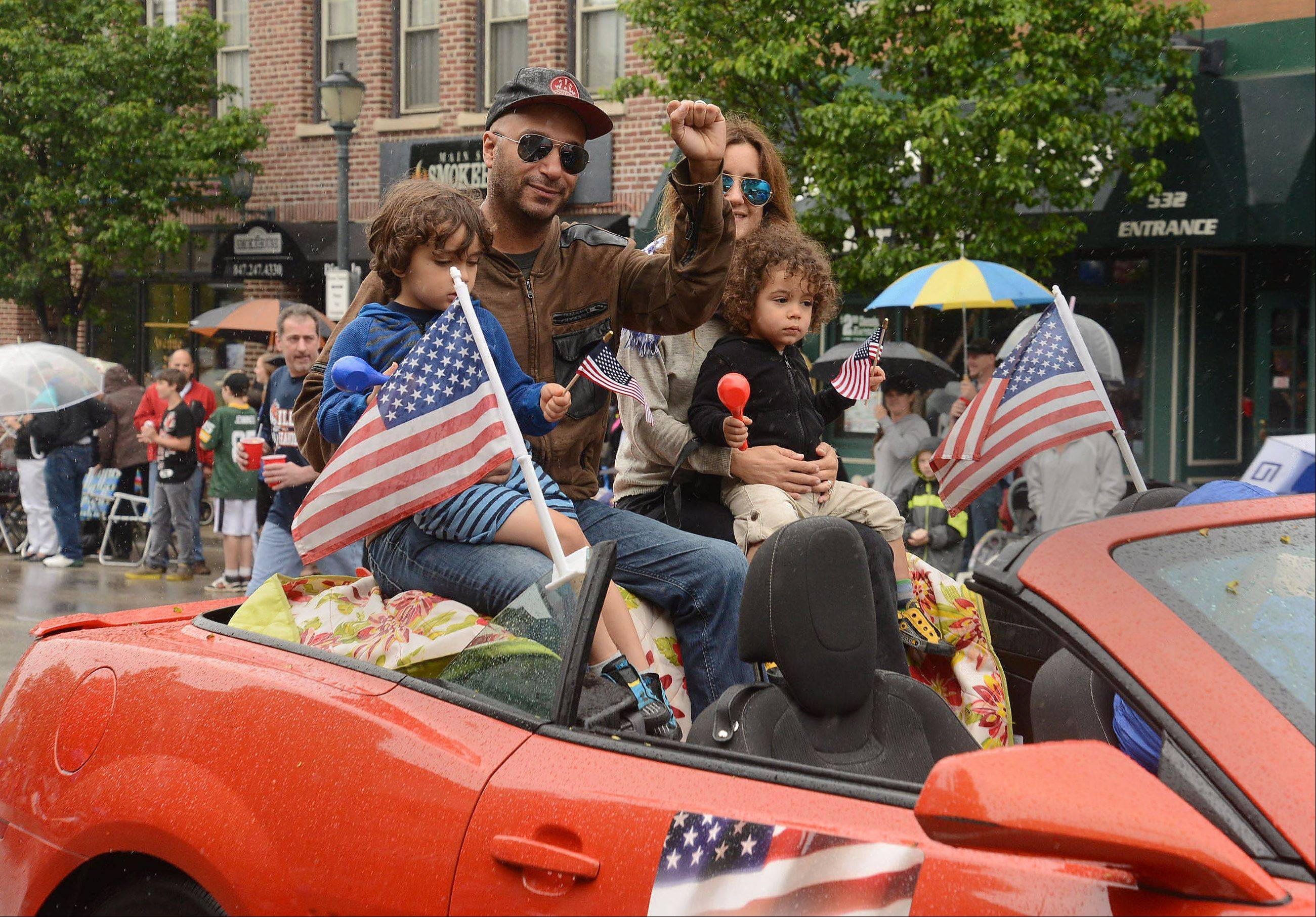 Grand Marshal Tom Morello and his family wave to the crowd during Saturday's Libertyville Days Parade.