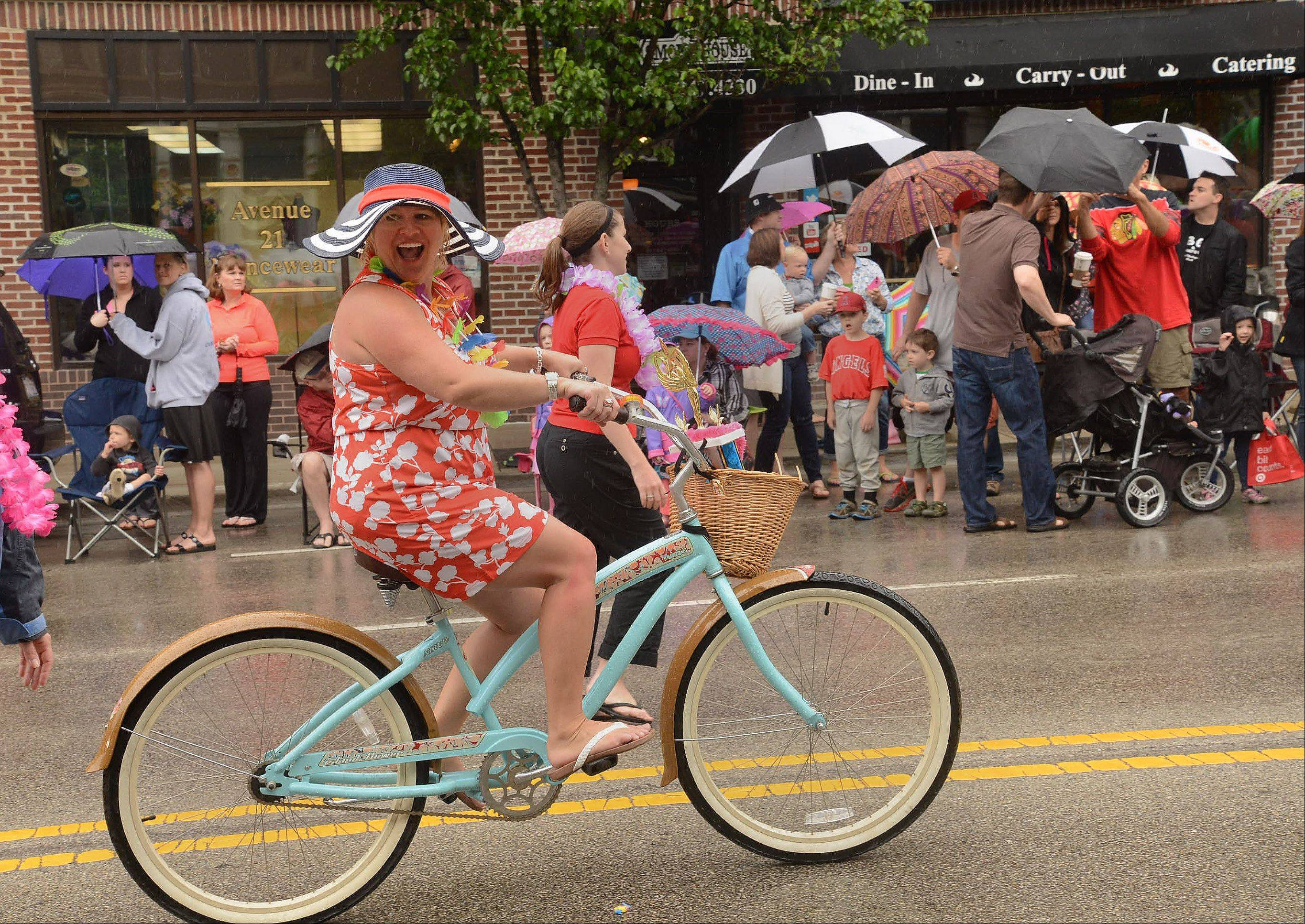 Some wore hats, but umbrella's seemed to be the protection of choice against the rain during Saturday's Libertyville Days Parade.