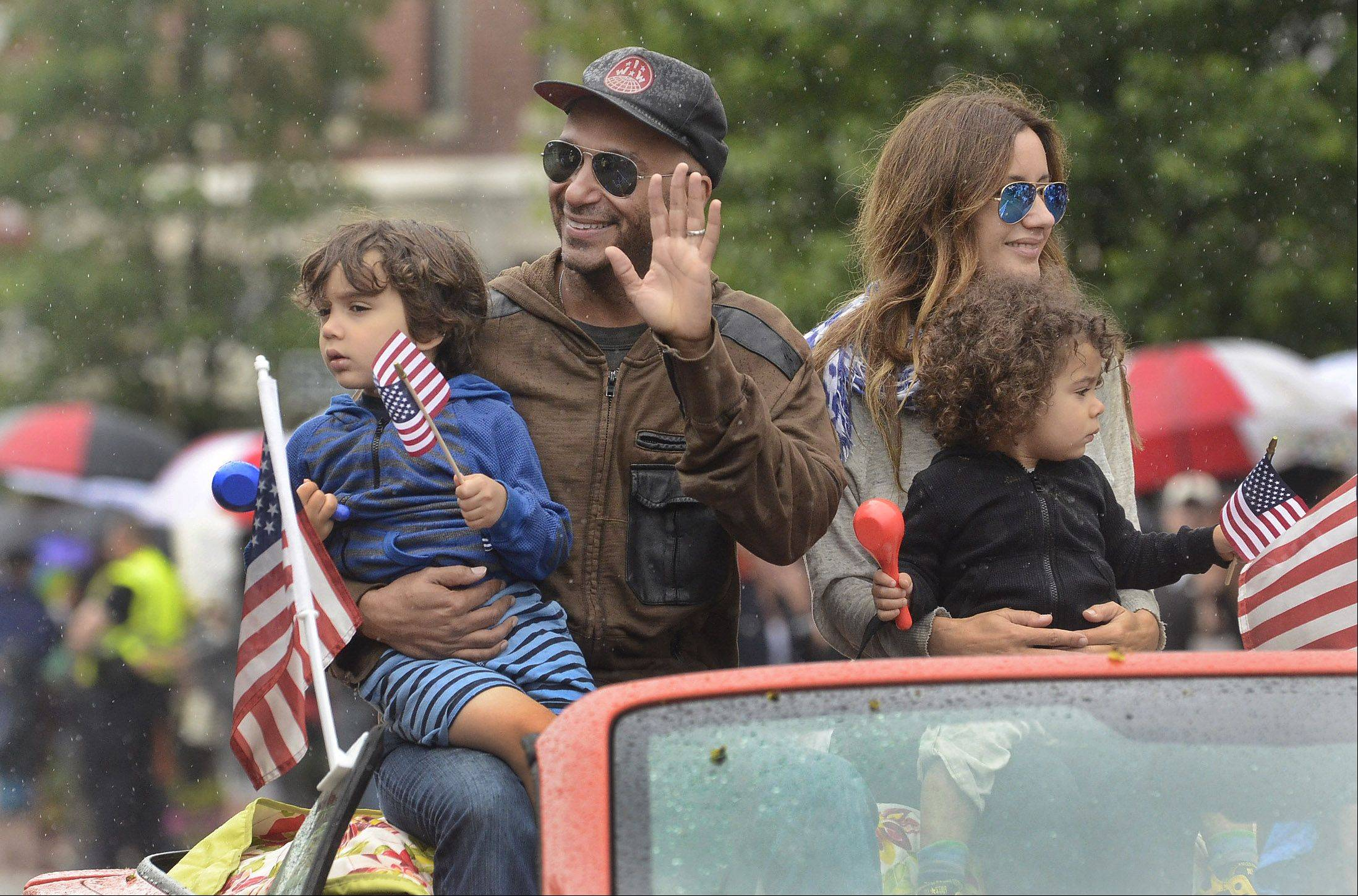 Musician Tom Morello, grand marshal of Saturday's Libertyville Days Parade, and his family wave to the crowd.