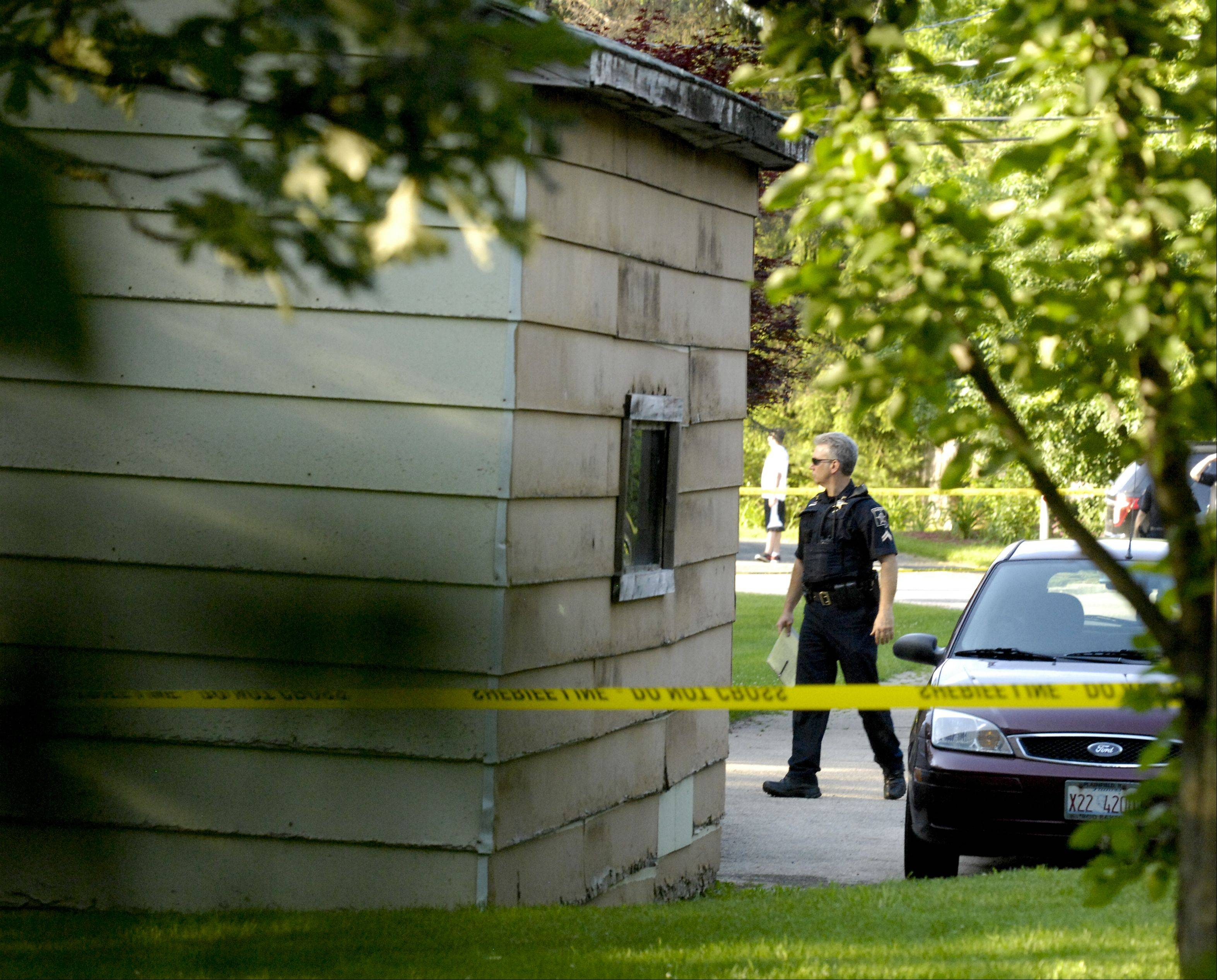 Police investigate a murder-suicide Tuesday at a house on Oldfield Road near Darien.