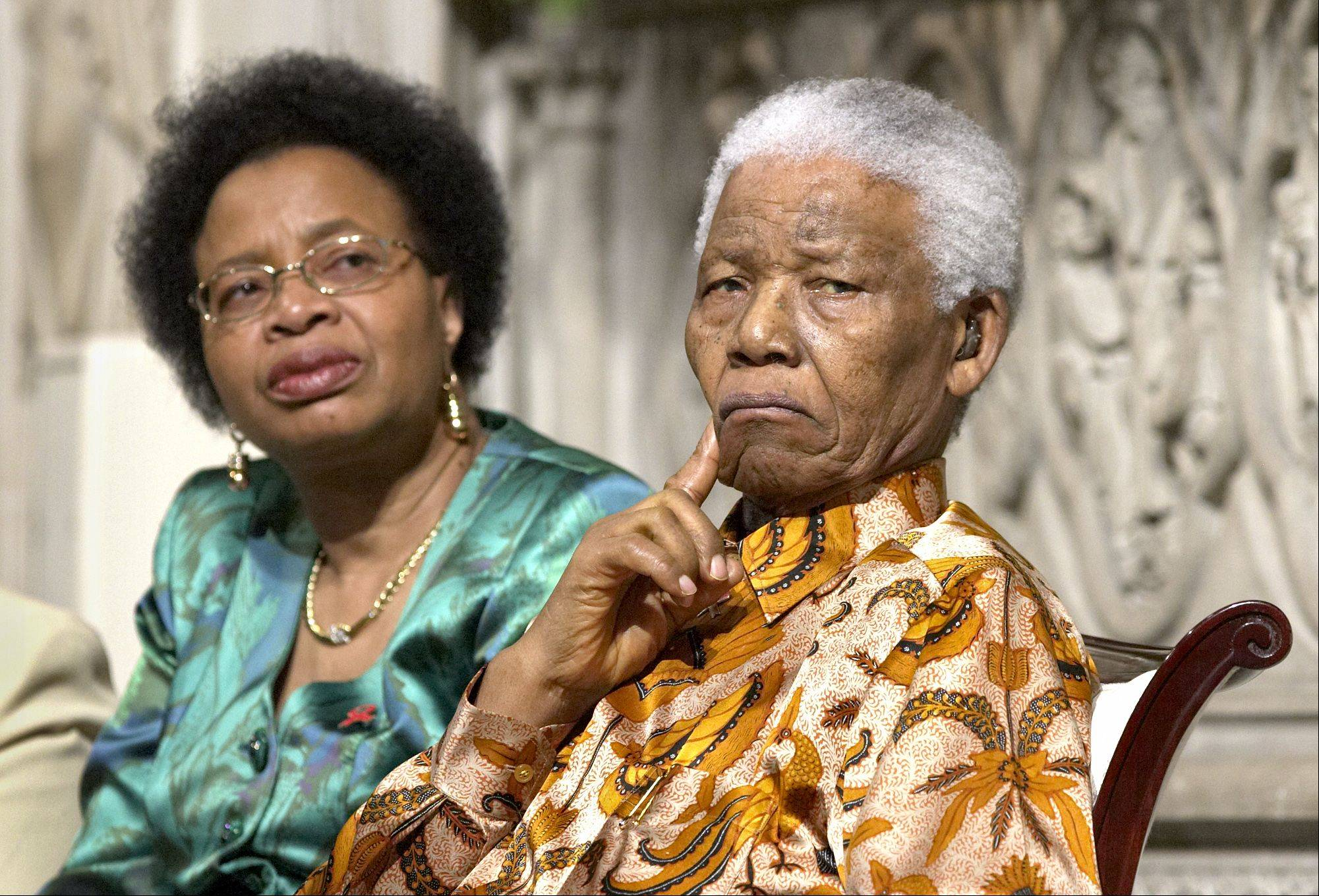 Former South African President Nelson Mandela, right, and his wife Graca Machel, left, attend Riverside Church in New York, on May 14, 2005.