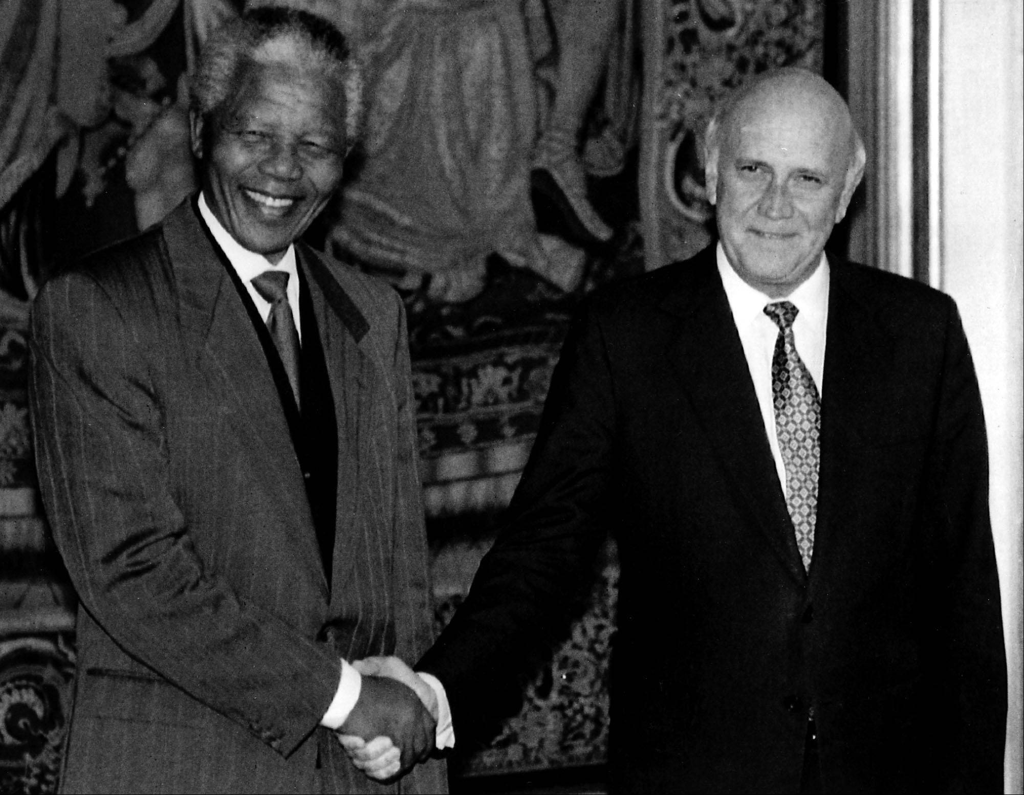 The two Nobel Peace Prize winners, ANC President Nelson Mandela (l) and South African President Frederik Willem de Klerk, shake hands during their meeting in Oslo, Thursday, December 09, 1993.