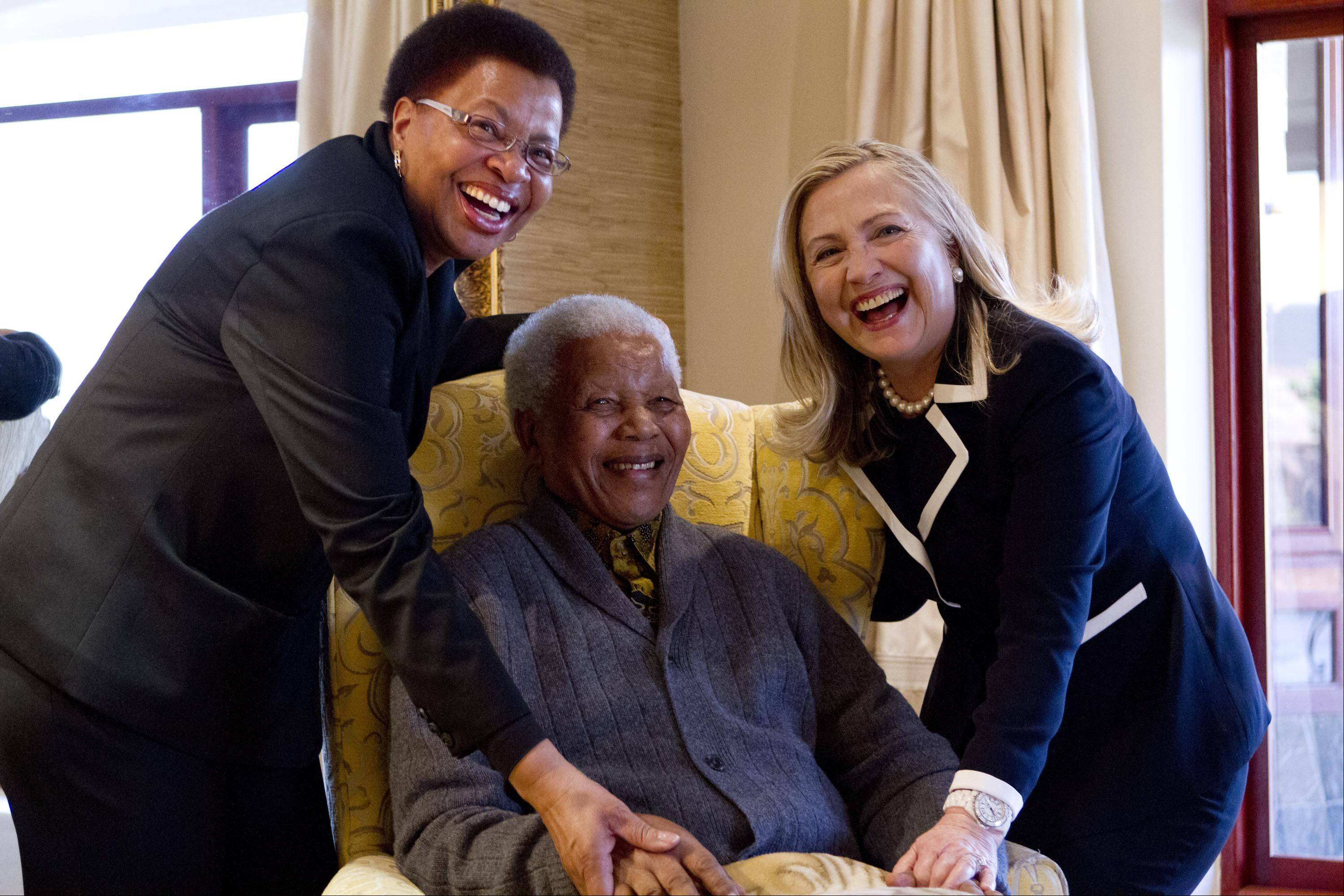 Secretary of State Hillary Rodham Clinton meets with former South Africa President Nelson Mandela, 94, and his wife Graca Machel at his home in Qunu, South Africa, Monday, Aug. 6, 2012.