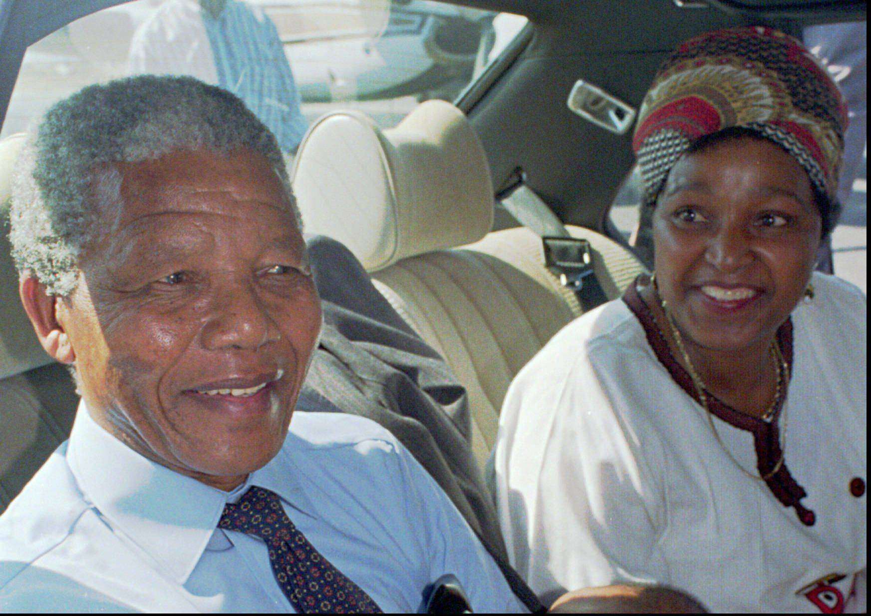 Nelson Mandela, left, and his wife Winnie, right, at Cape Town's airport prior to a flight to Johannesburg in this February 1990 photo, the day after his release from prison.