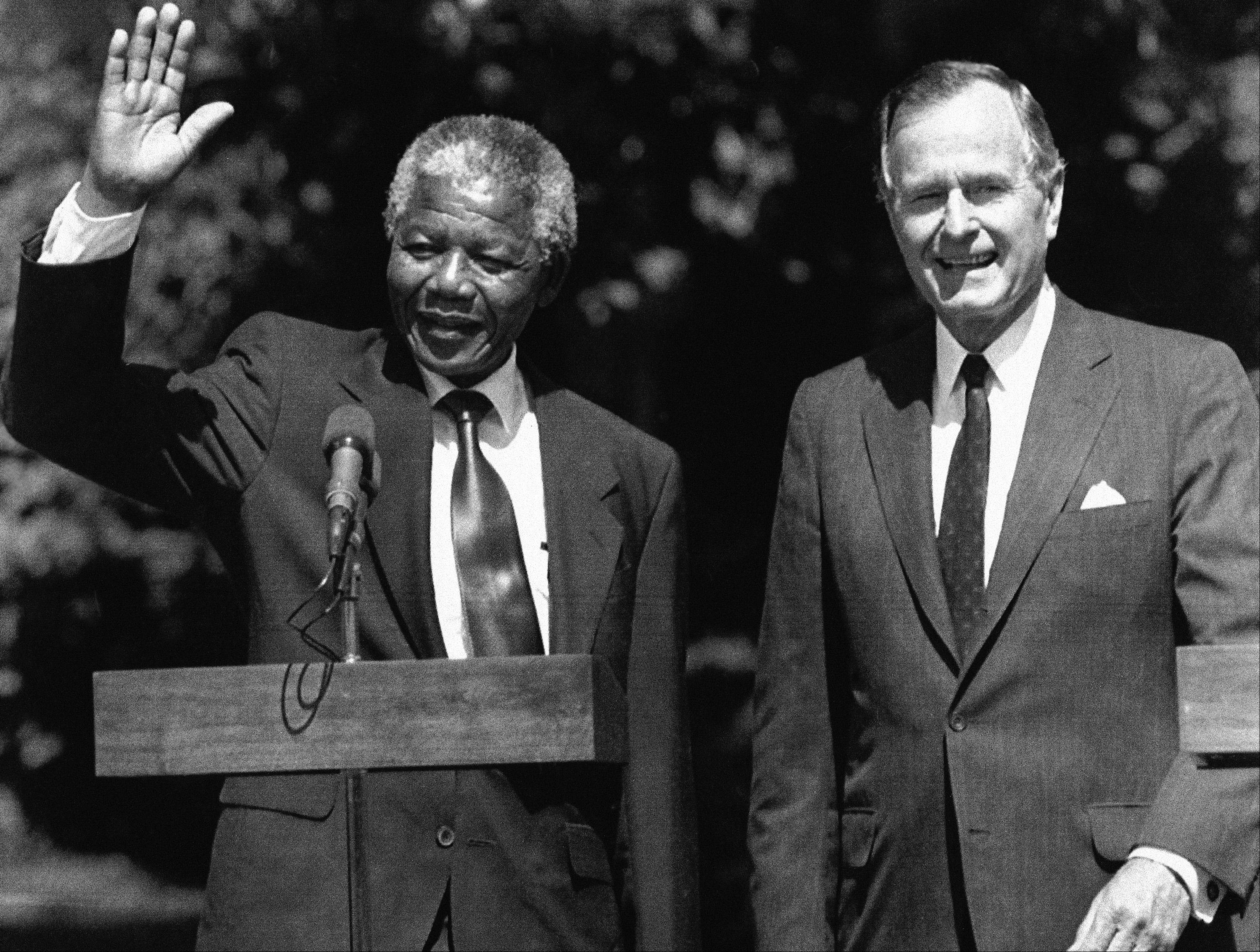 President George Bush greets South African leader Nelson Mandela on the South Lawn of the White House, Monday, June 26, 1990, Washington, DC.