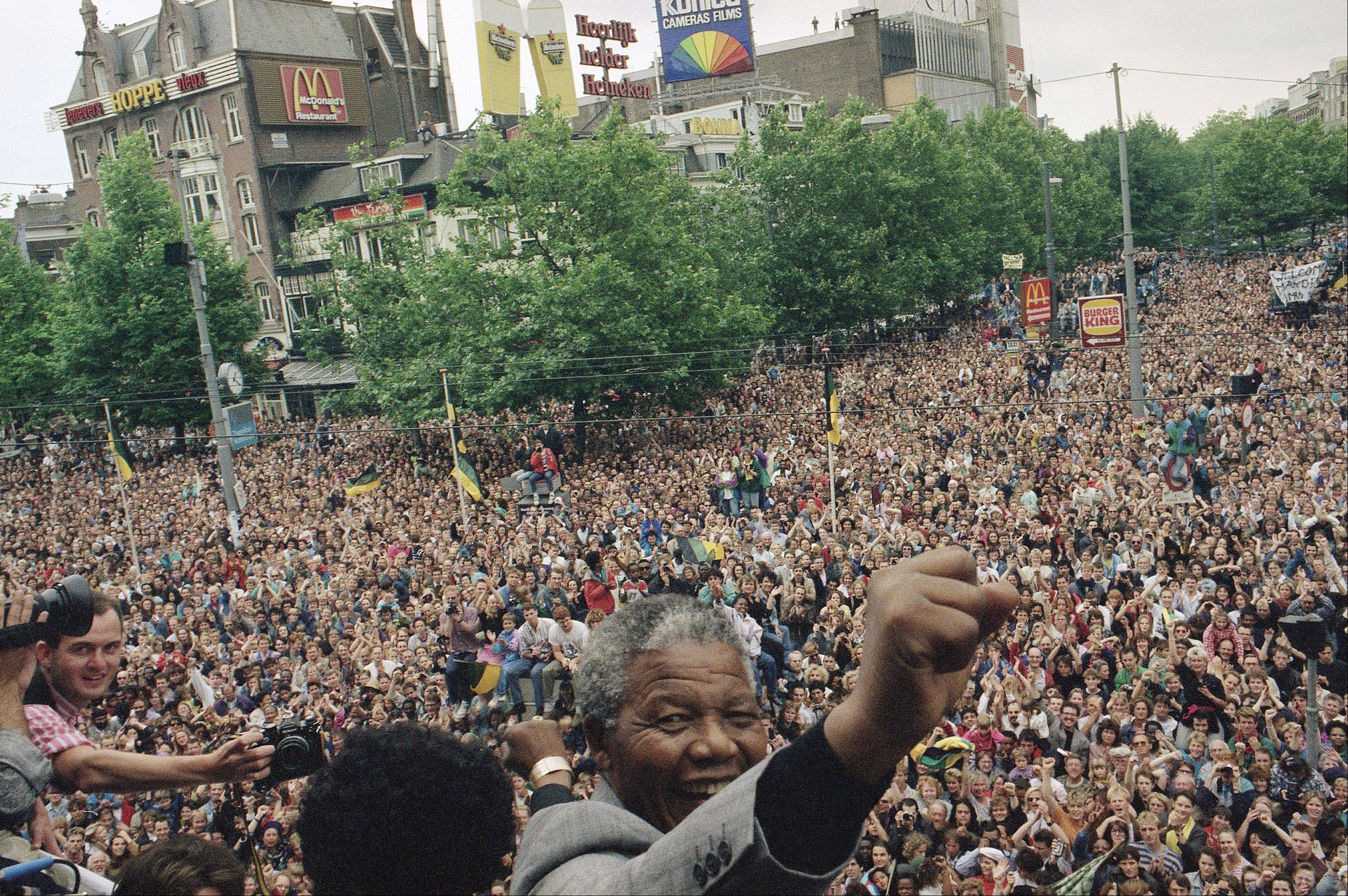 South African leader of the ANC Nelson Mandela raises his fist after addressing a crowd of about 15,000 people from the balcony of the city theater Saturday, June 16, 1990 in Amsterdam.