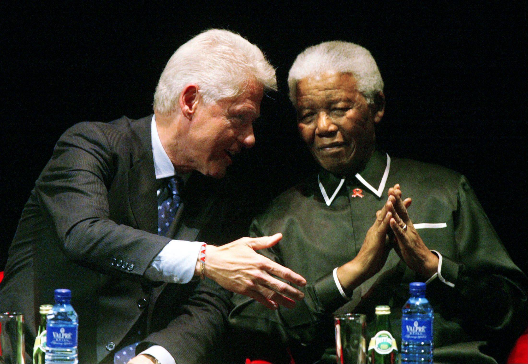 Former South African President Nelson Mandela, right, with former U.S. President Bill Clinton, left, during the Nelson Mandela Annual Lecture Tuesday, July 19, 2005.