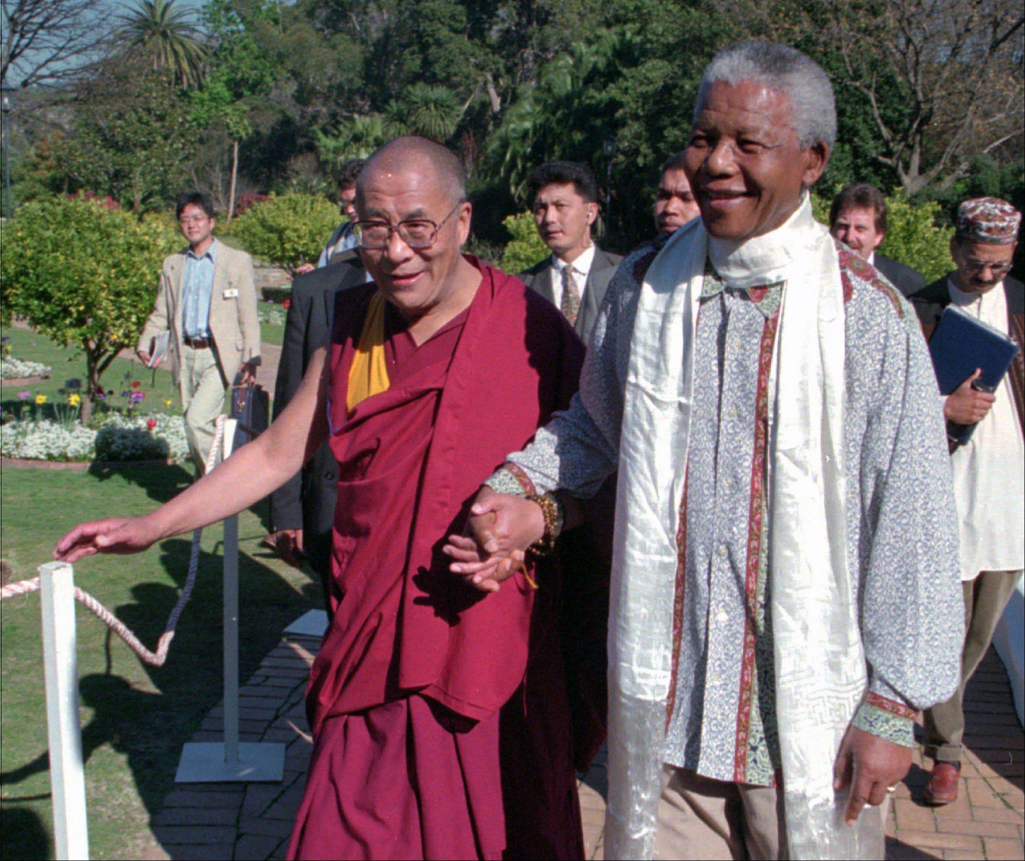 In this Wednesday August 21, 1996, file photo Tibetan leader the Dalai Lama, left, meets with President Nelson Mandela, right, in Cape Town South Africa.