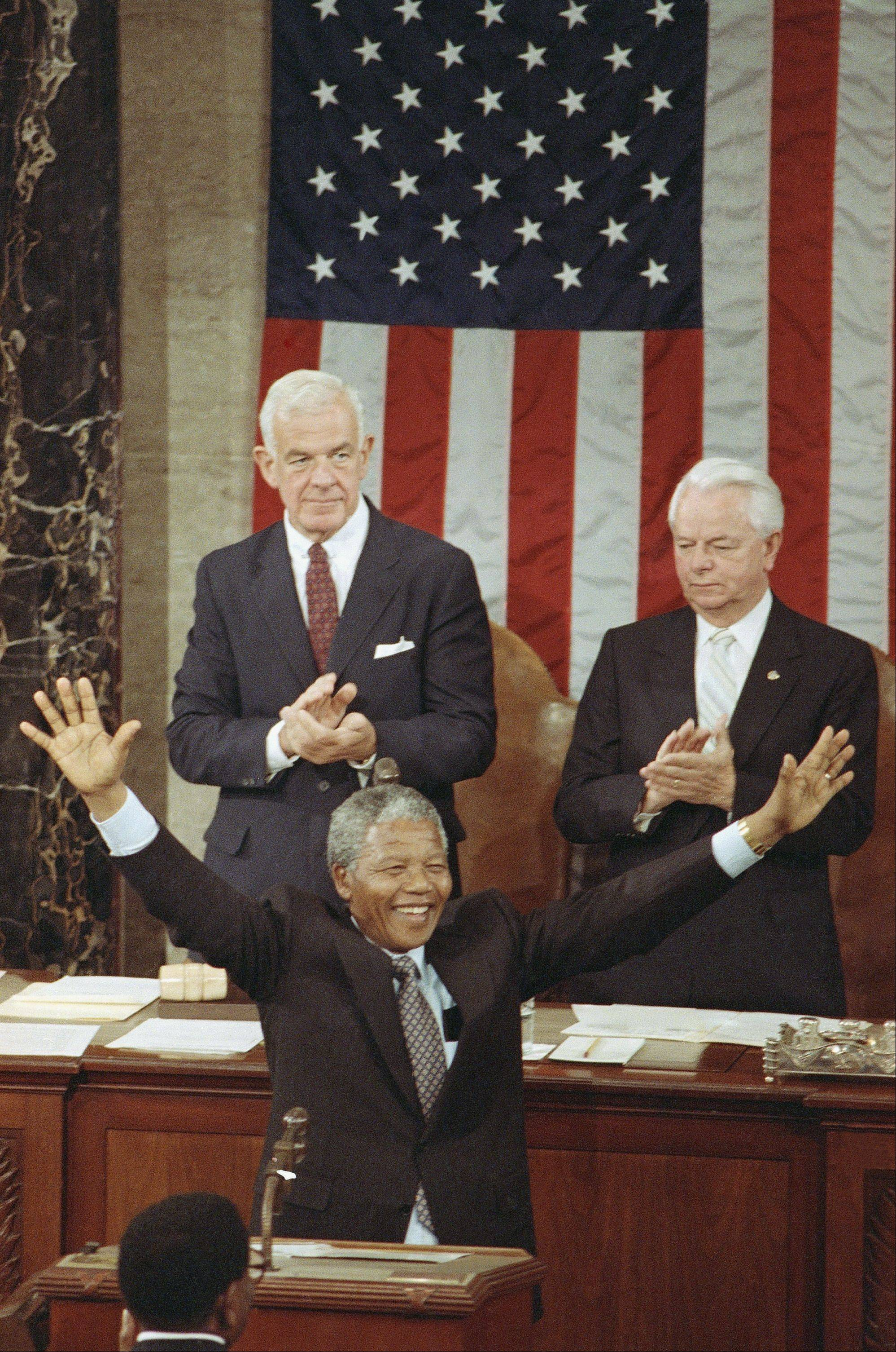 Nelson Mandela, Deputy President of the African National Congress, acknowledges applause as he stands before a Joint Meeting of Congress on Capitol Hill in Washington Tuesday, June 26, 1990.