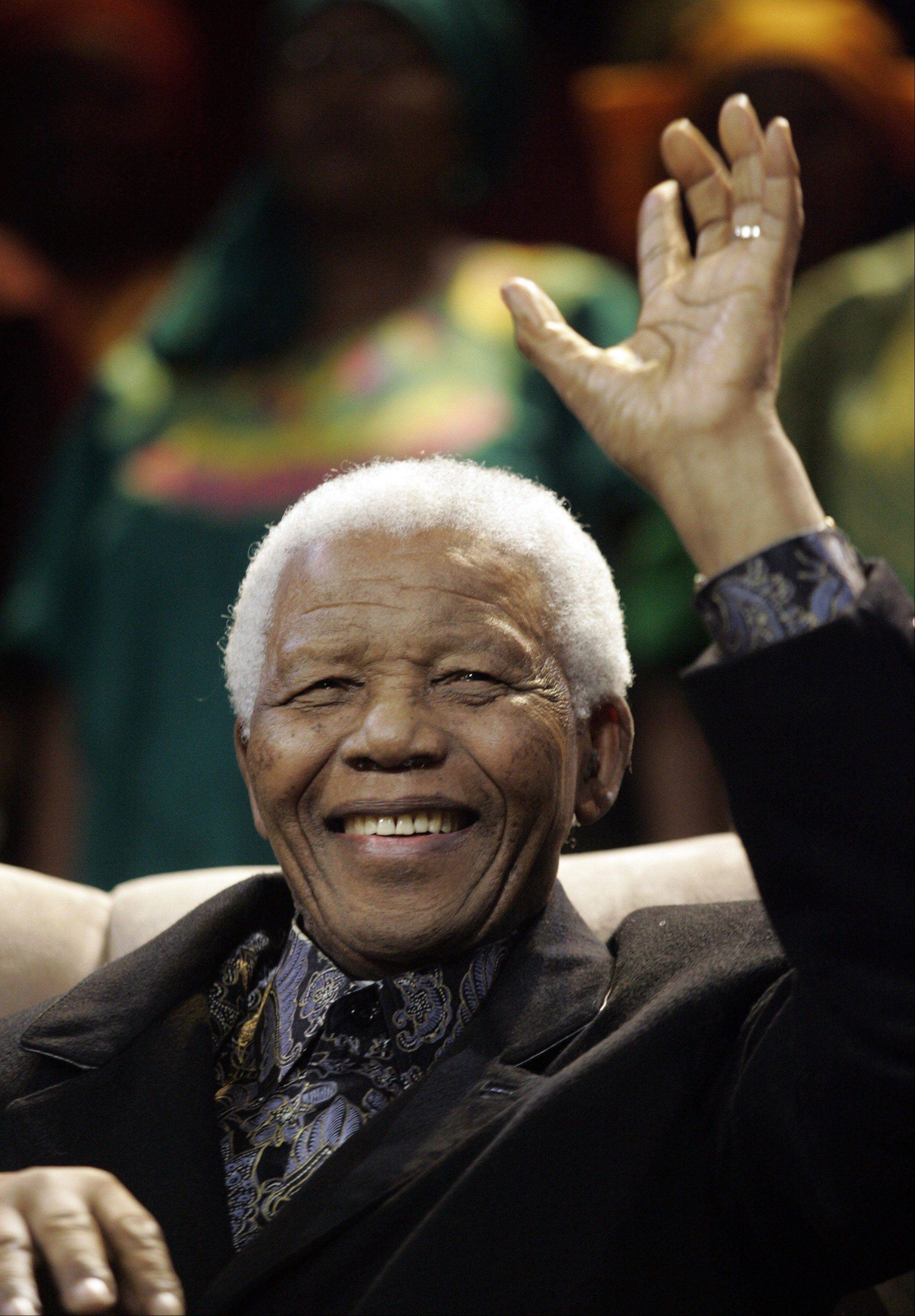 Former South Africa's President Nelson Mandela waves, after his arrival for the 6th Annual Mandela Lecture in Soweto, South Africa, Saturday, July 12, 2008.
