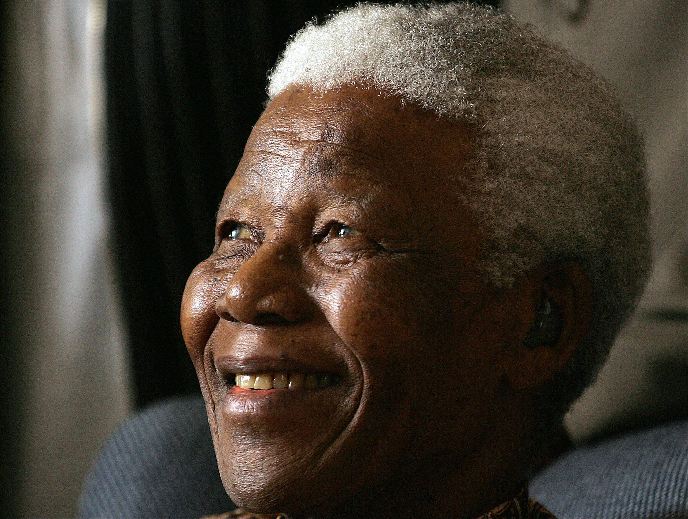 Former South African President Nelson Mandela smiles during his meeting with a group of Mandela Rhodes Scholars for 2006, in Johannesburg, South Africa Jan. 31, 2006.