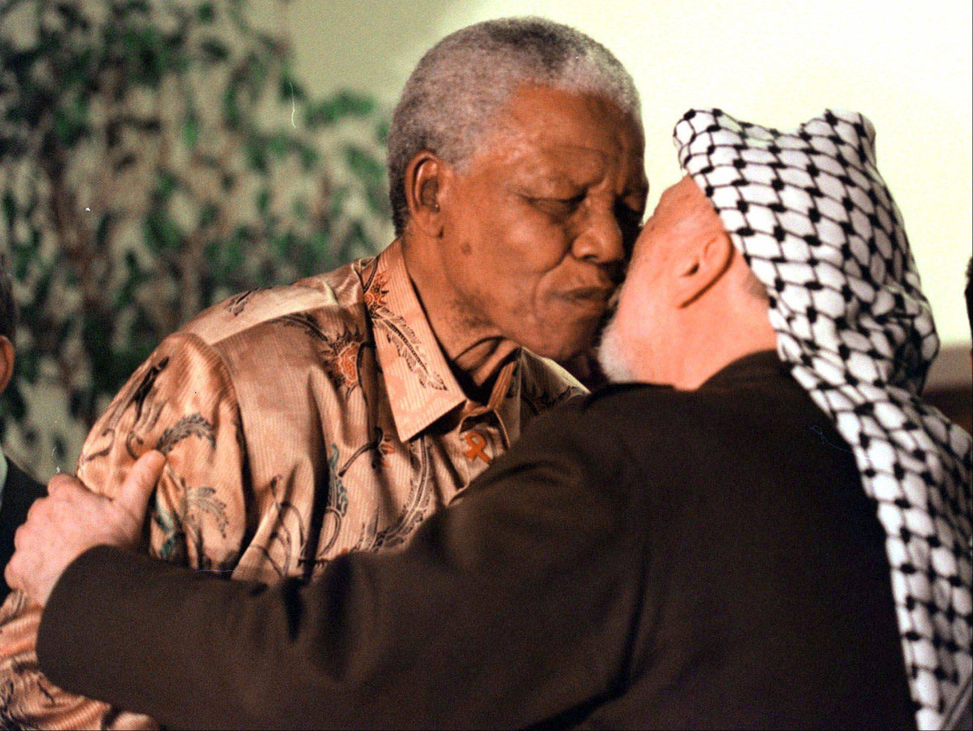 Former South African President Nelson Mandela, left, greets Palestinian leader Yasser Arafat in Johannesburg, South Africa, Thursday, August 3, 2000.