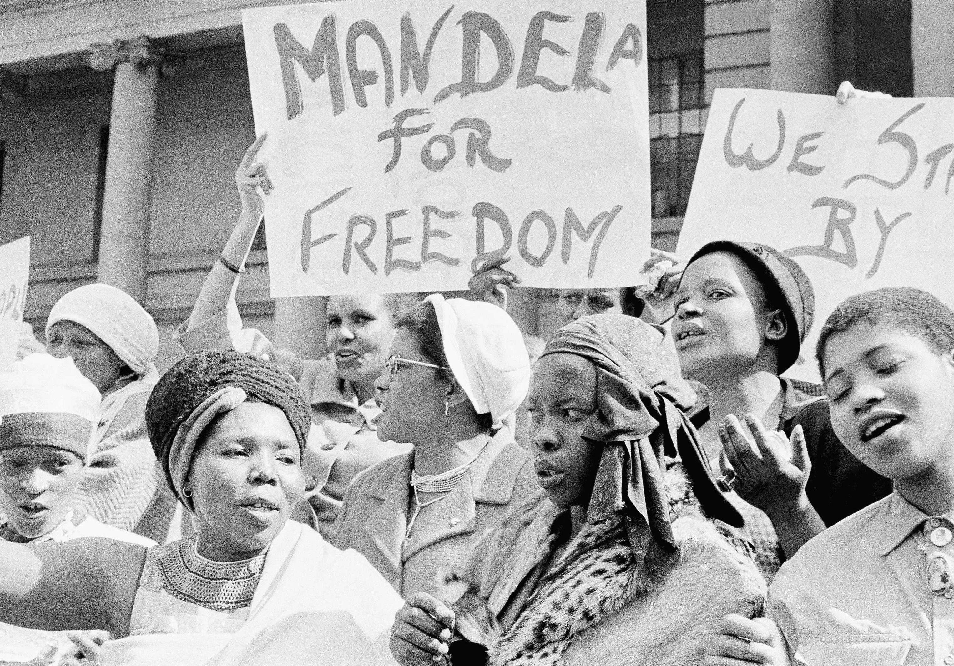 "African women join in a demonstration in South Africa, Aug. 16, 1962, demanding the release of Nelson Mandela. The women, together with Winnie Mandela chanted ""down with Verwoerd on the steps of the Johannesburg City Hall."
