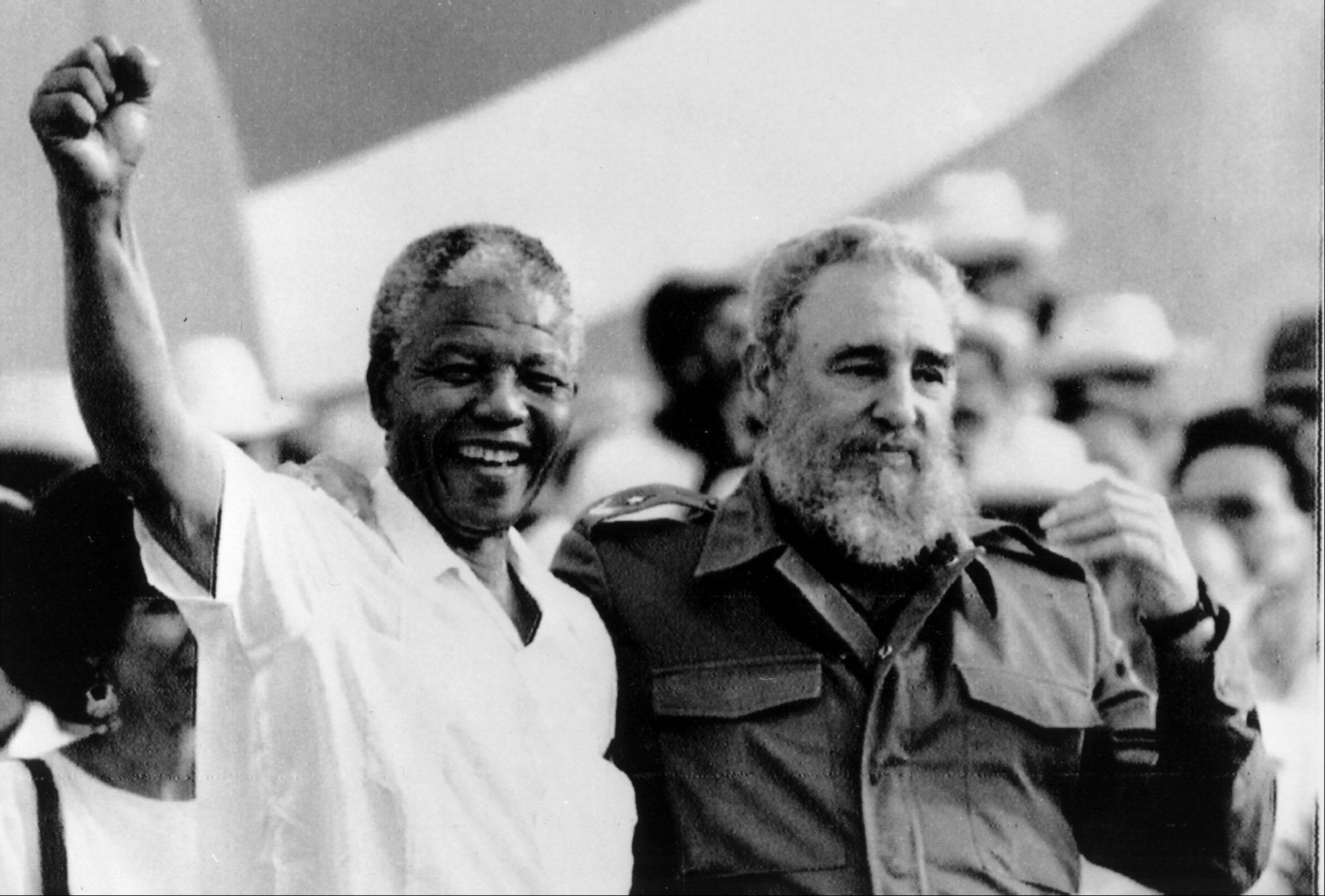 "Cuban President Fidel Castro, right, and African leader Nelson Mandela gesture during the celebration of the ""Day of the Revolution"" in Matanzas Saturday, July 27, 1991. Cubans celebrate 38th anniversary of the revolution."