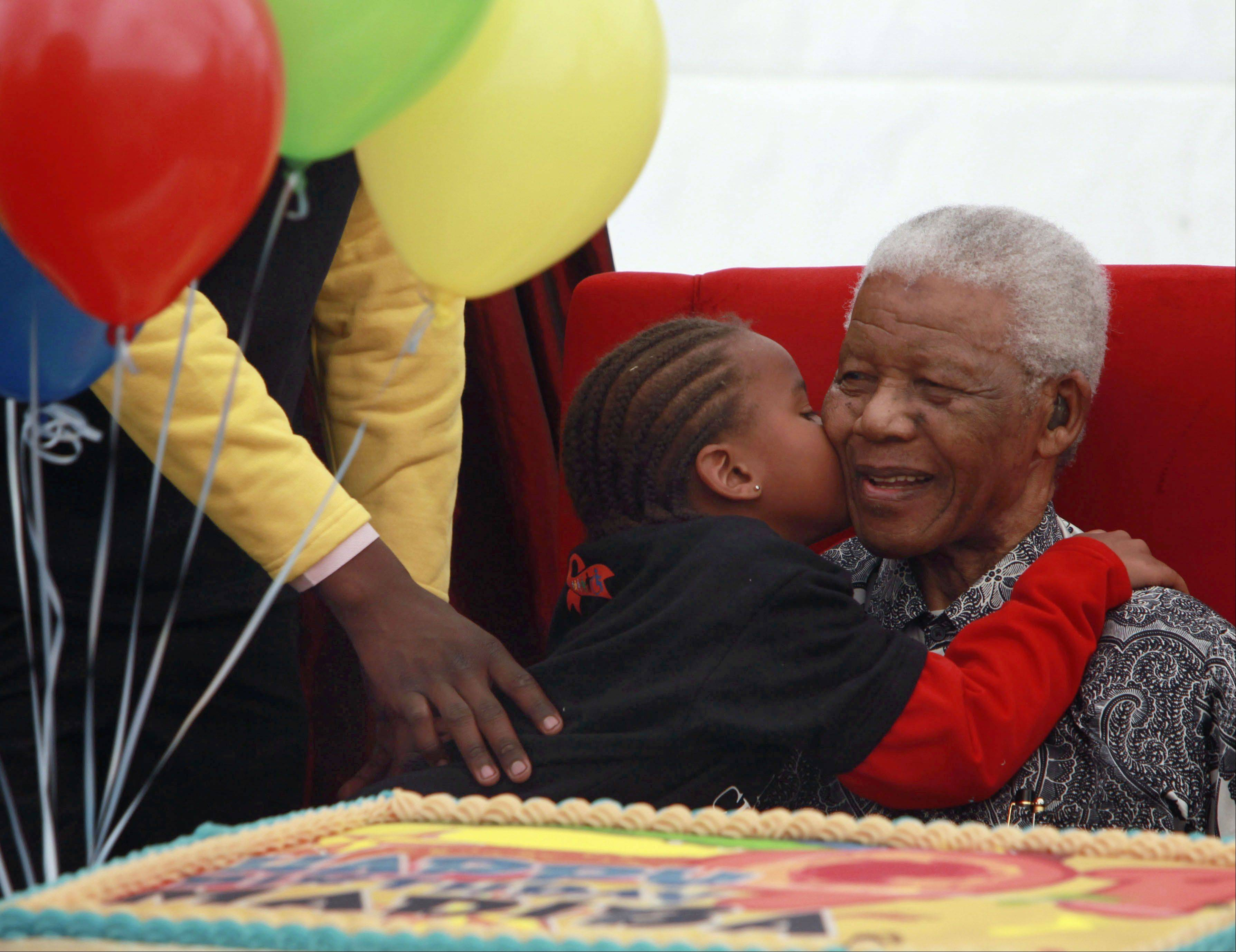 A child kisses Nelson Mandela, July 31, 2009 during the launch of a children's hospital in Johannesburg, South Africa.