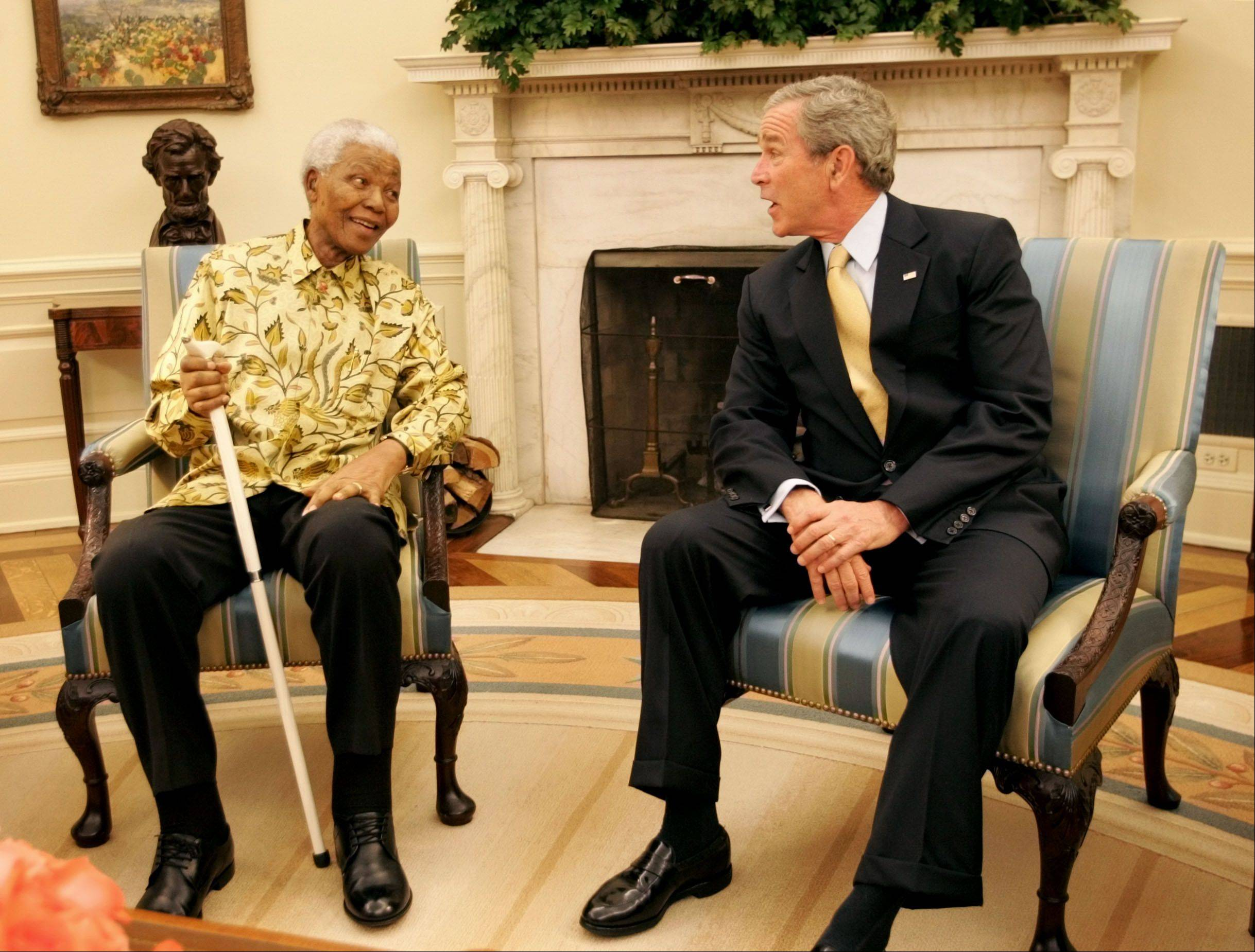 President Bush, right, meets with Former President of South Africa Nelson Mandela, left, in the Oval Office of the White House May 17, 2005, in Washington.
