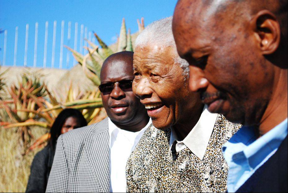 Former South African President Nelson Mandela, center, is seen smiling during his tour of Freedom Park in Pretoria, South Africa Thursday July 2nd, 2009.