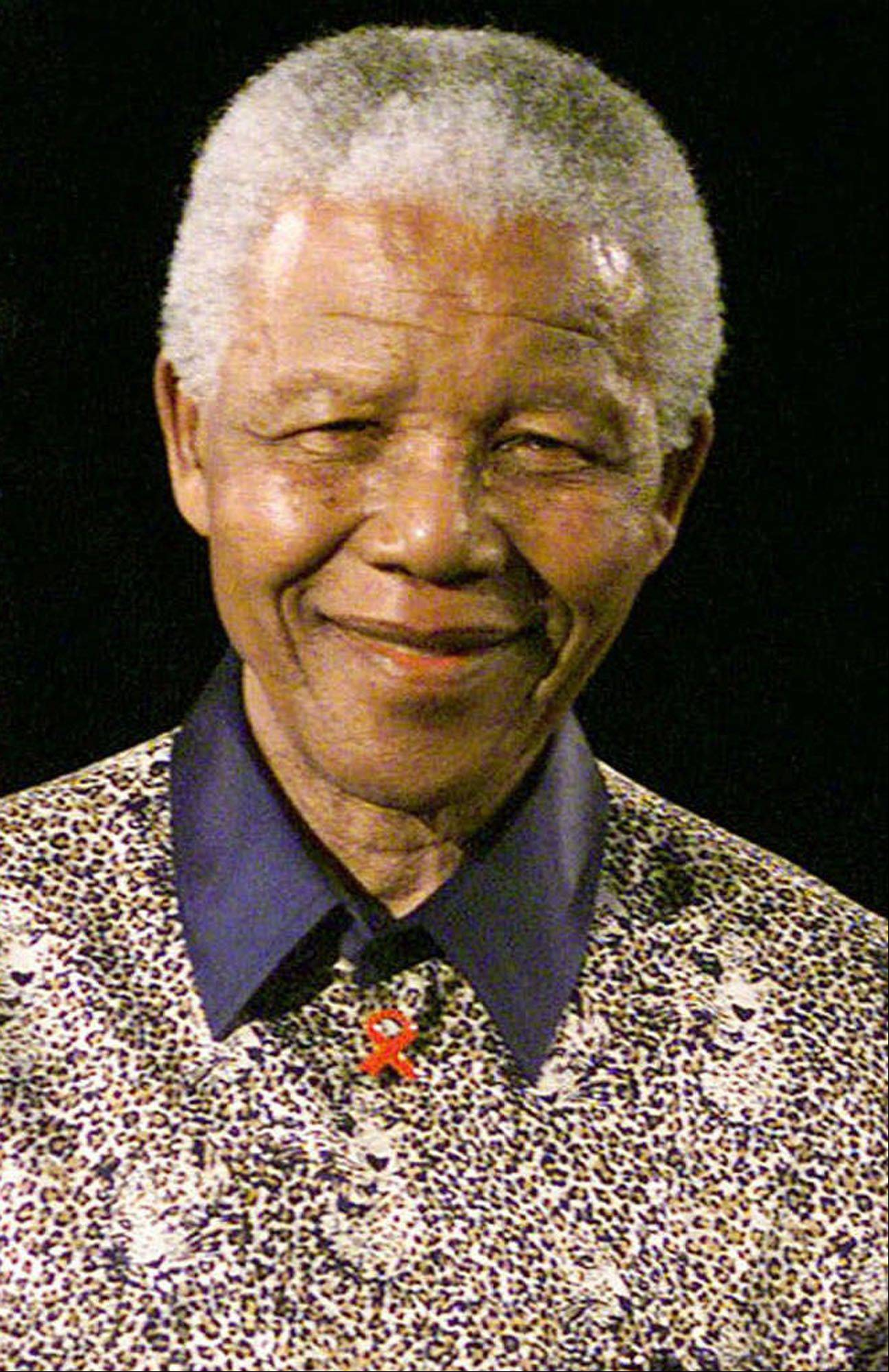 Former South African President and Nobel Peace Prize winner Nelson Mandela smiles during a forum at the University of Sydney in Sydney, Australia, in this Sept. 3, 2000, file photo.