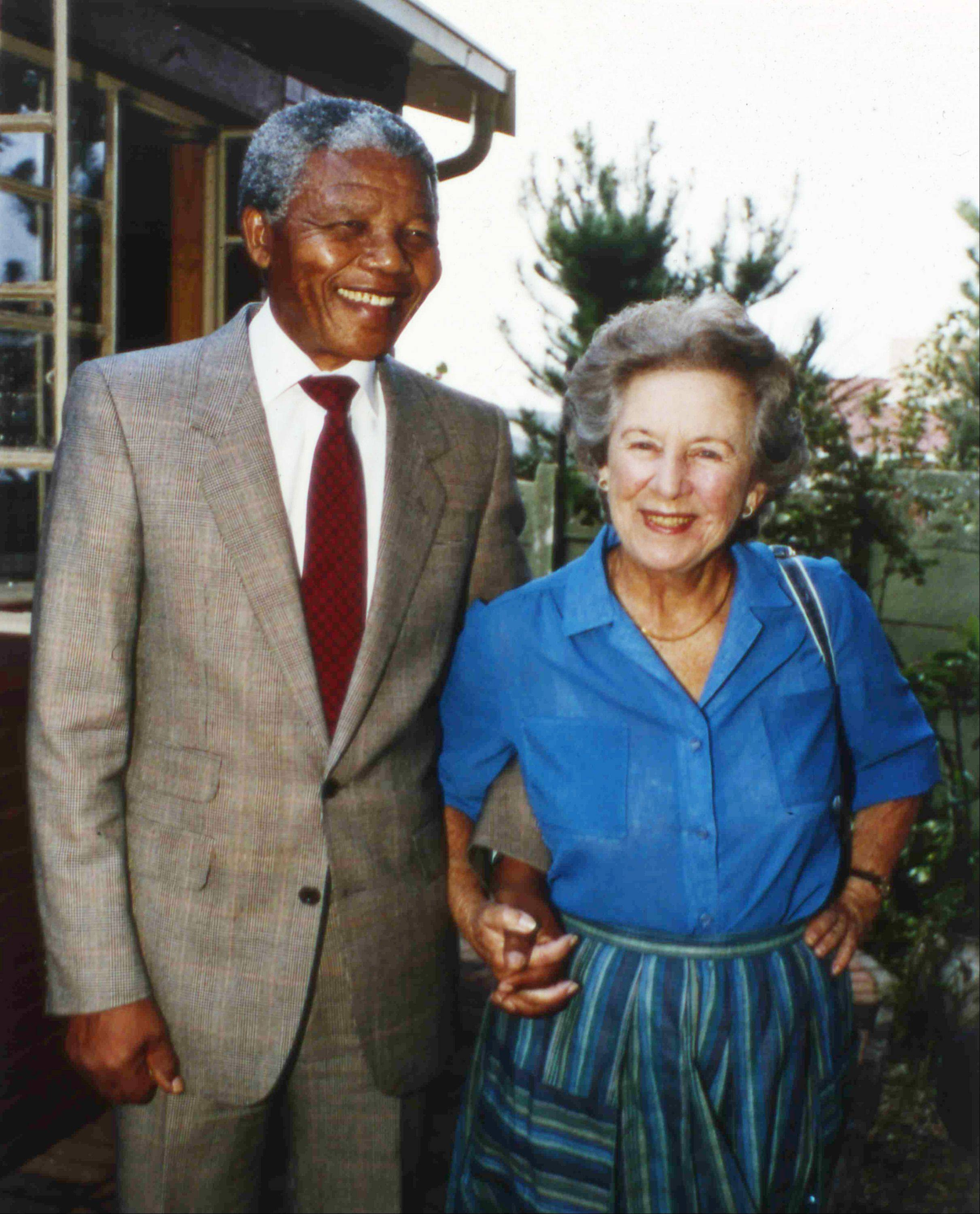Veteran anti-apartheid ex-member of Parliament, Helen Suzman, right, holds hands with recently released ANC leader Nelson Mandela, when Suzman visited Mandela at his Soweto home, Feb. 26, 1990.