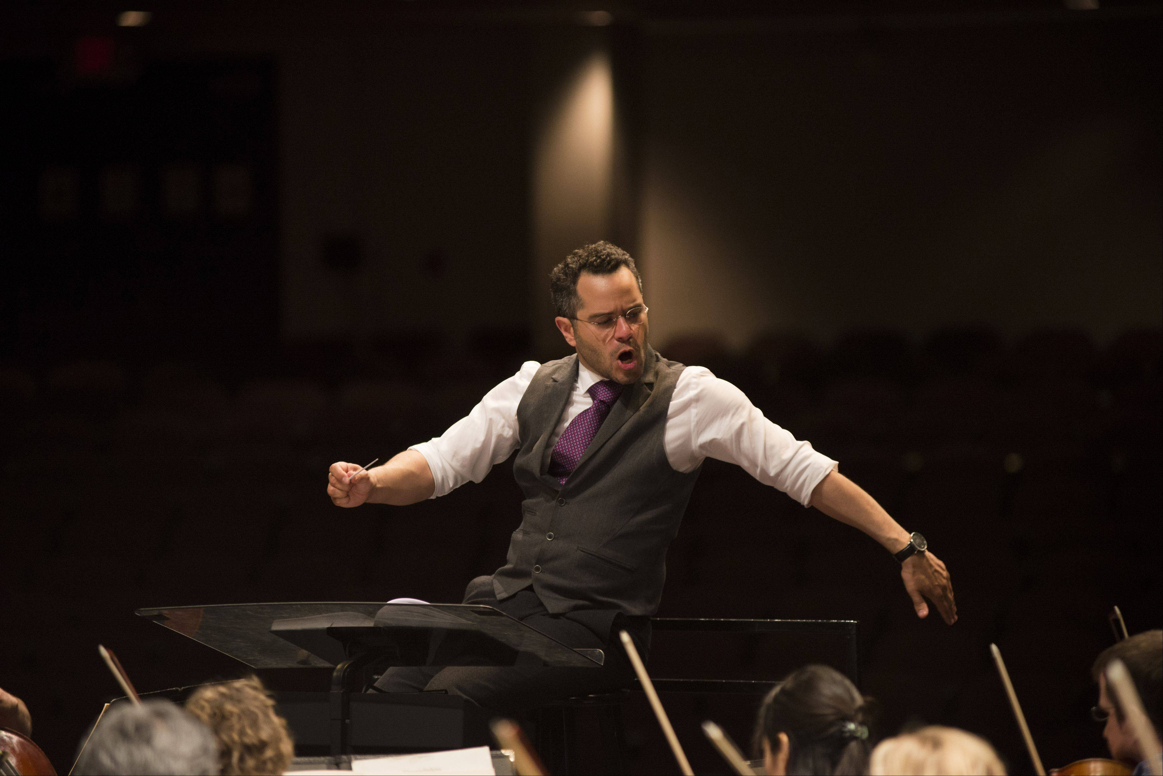 Andrew Grams, who signed a three-year contract to serve at the Elgin Symphony Orchestra's new music director, most recently conducted the ESO in early May, after a first appearance a few years ago.