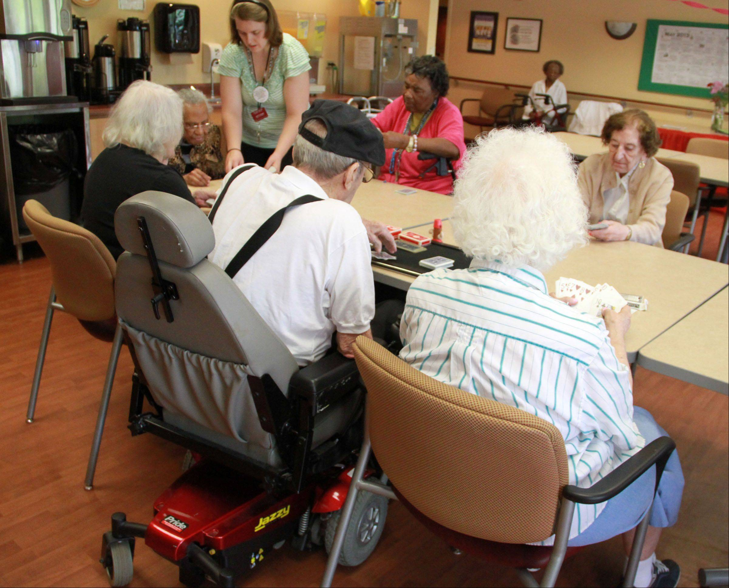 Don Theobald teaches a magic class at Victory Centre of River Woods, the assisted living facility where he lives, in Melrose Park.