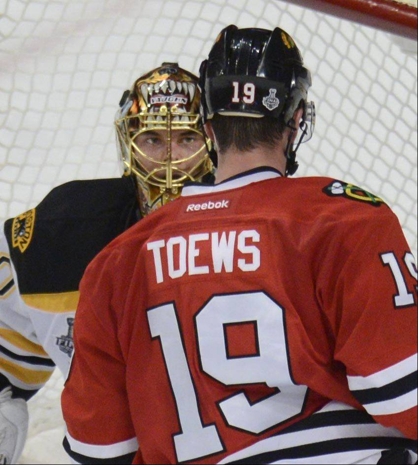 Boston Bruins goalie Tuukka Rask and Chicago Blackhawks center Jonathan Toews come face to face in the second period.