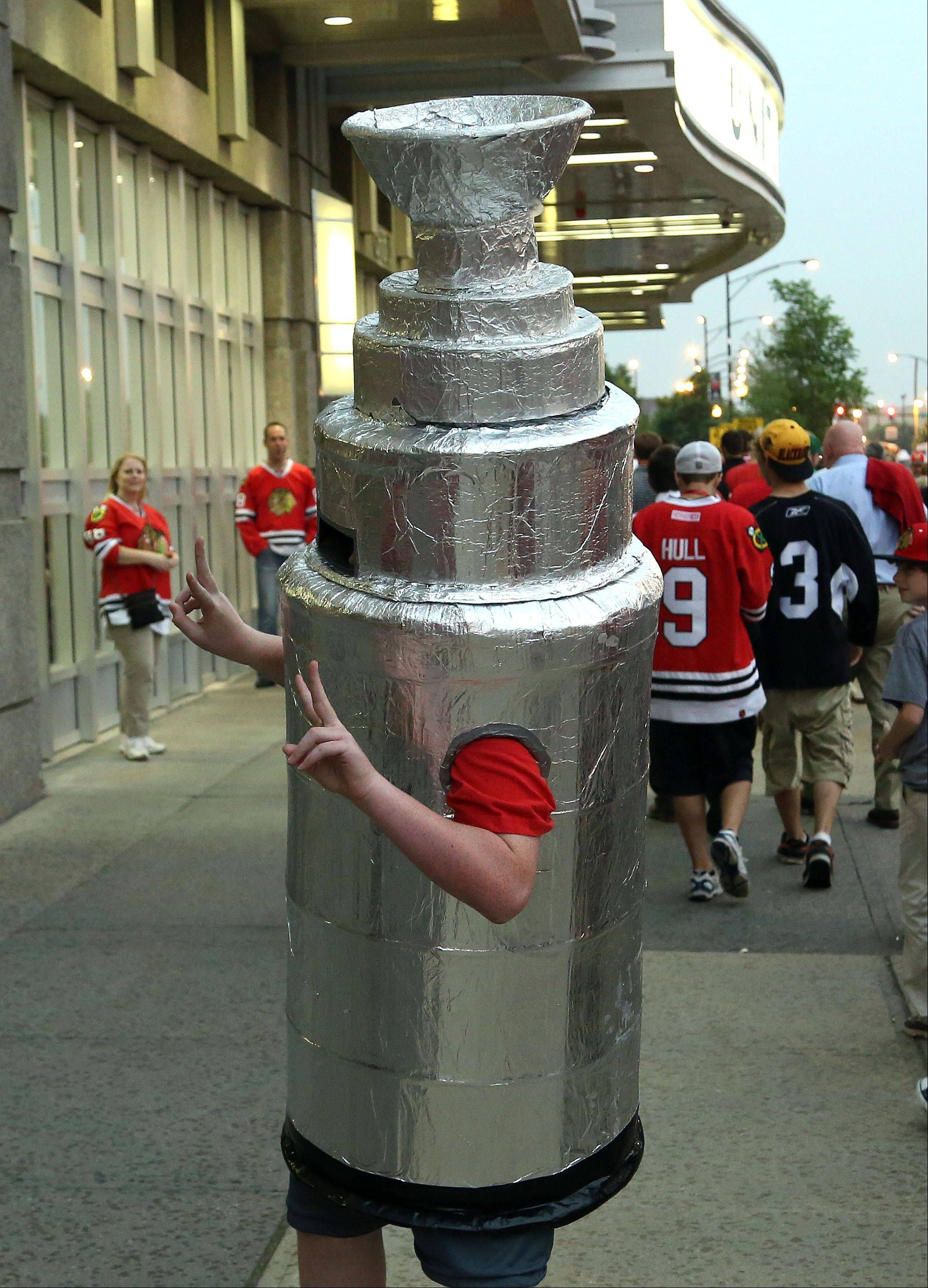 Tommy Schmidt of Chicago walks around the United Center dressed as the Stanley Cup.