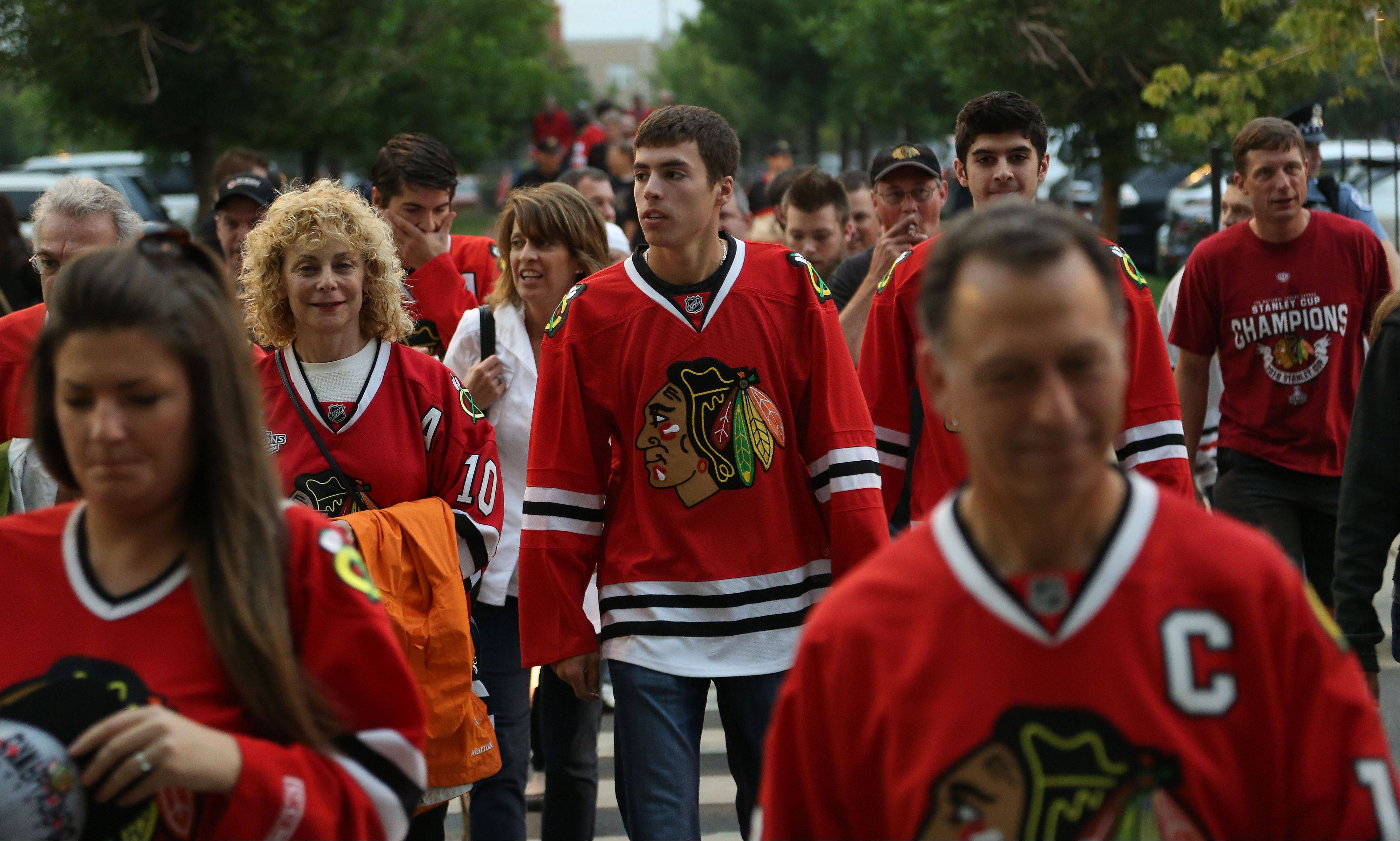 Blackhawks fans are all red as they make their way into the United Center.