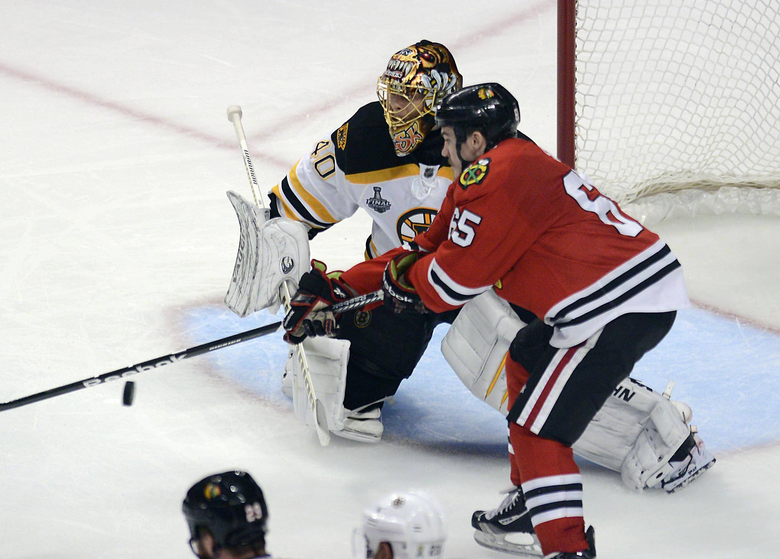 Chicago Blackhawks center Andrew Shaw deflects a shot past Boston Bruins goalie Tuukka Rask for the game winner in the third overtime during Game 1 of the Stanley Cup Finals Wednesday at the Untied Center in Chicago.