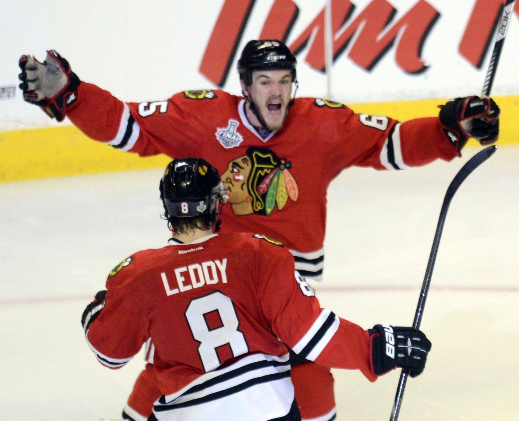 Chicago Blackhawks center Andrew Shaw reacts after scoring the game winning goal in the third overtime against the Boston Bruins during Game 1 of the Stanley Cup Finals Wednesday at the Untied Center in Chicago.