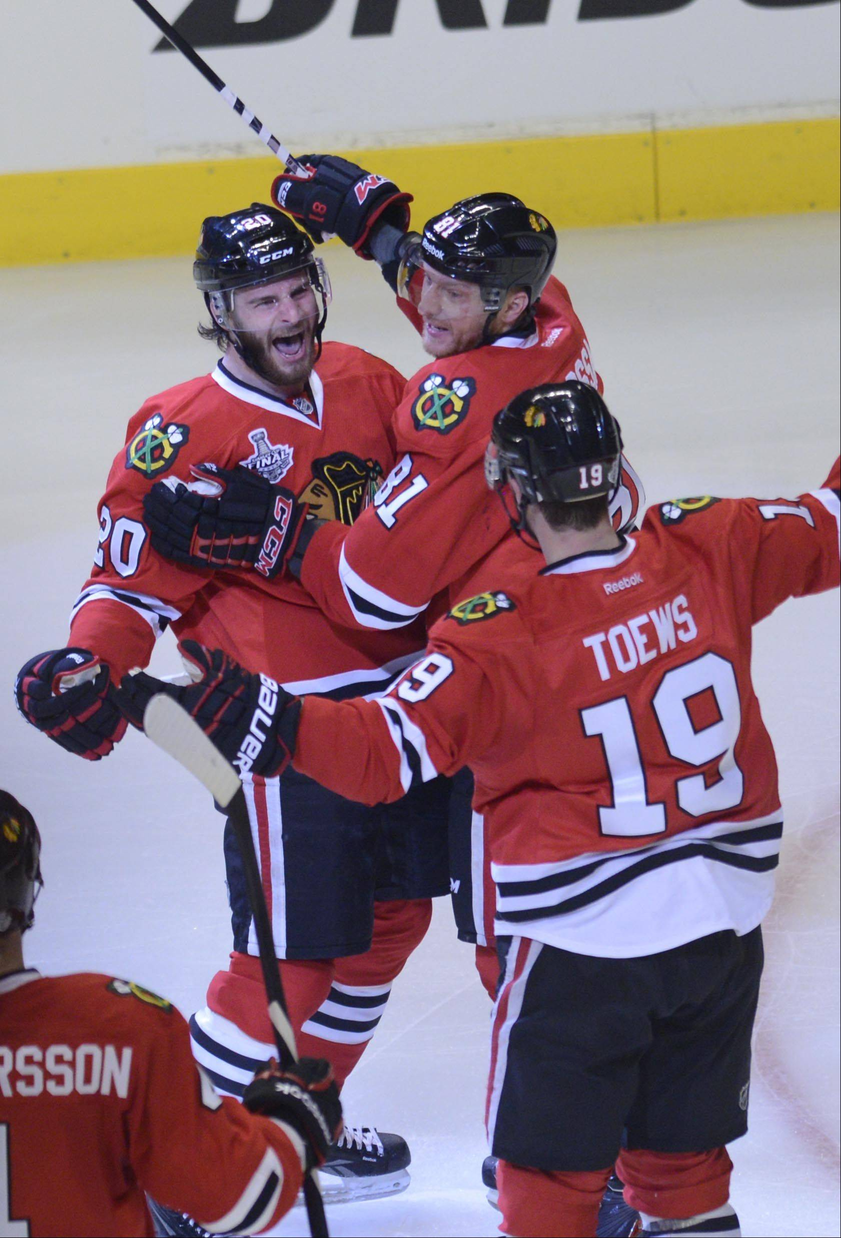 Chicago Blackhawks left wing Brandon Saad celebrates his early second period goal with right wing Marian Hossa and center Jonathan Toews.