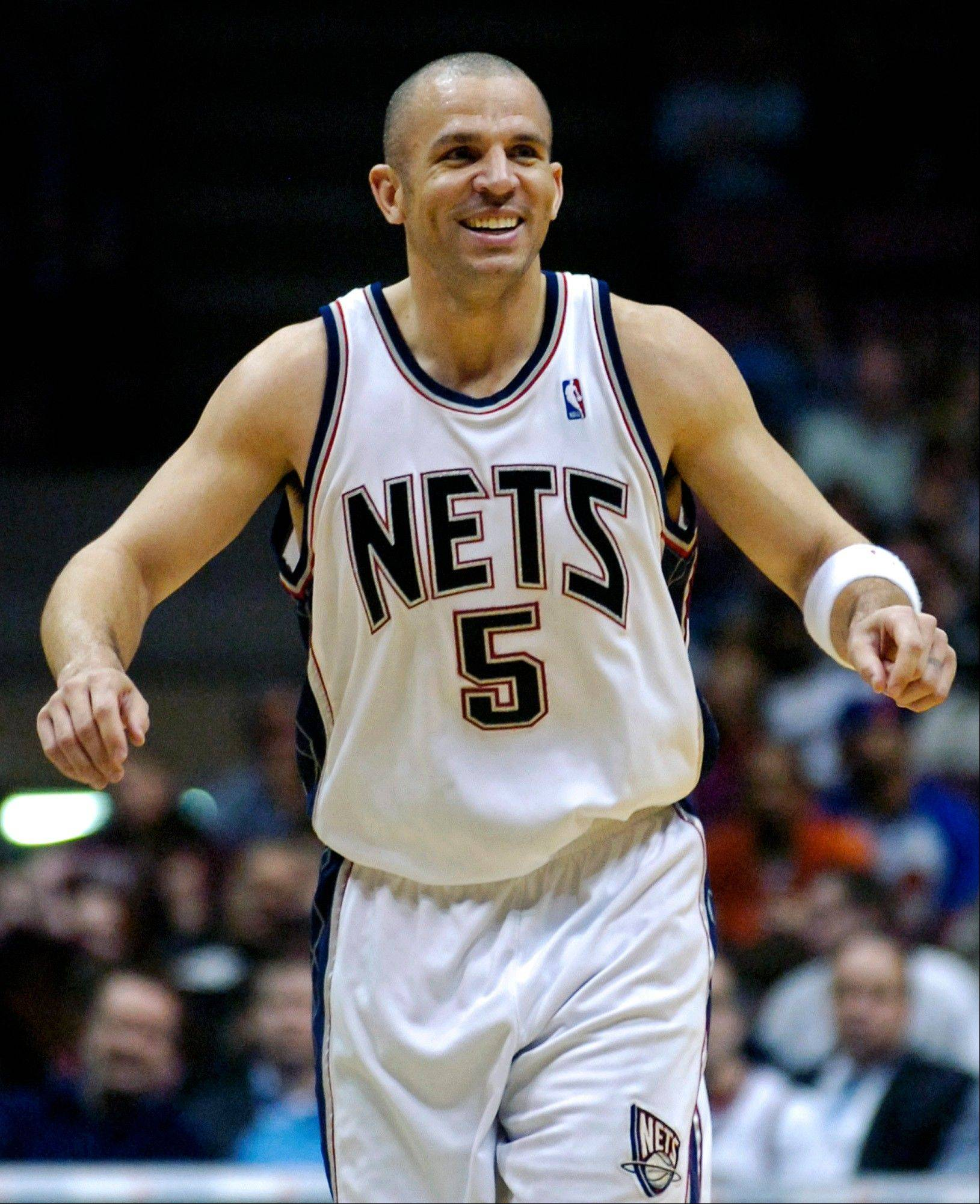 FILE - In this April 13, 2007, file photo, then-New Jersey Nets' Jason Kidd reacts during an NBA basketball game in East Rutherford, N.J. The Brooklyn Nets hired Jason Kidd as their coach Wednesday, June 12, 2013, bringing the former star back to the franchise he led to its greatest NBA success.