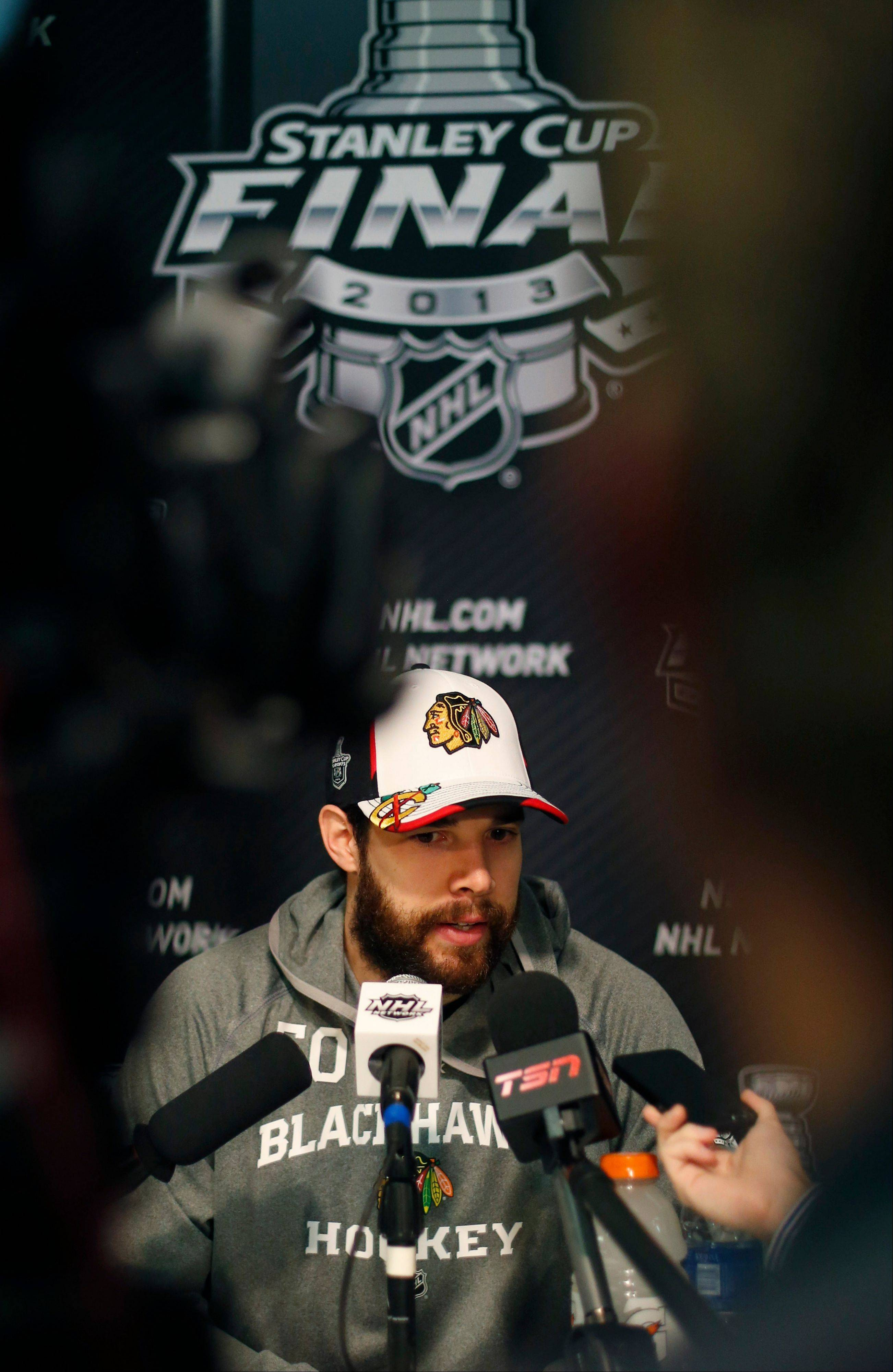 Chicago Blackhawks goalie Corey Crawford responds to a question during a news conference for the Stanley Cup Final hockey series against the Boston Bruins Tuesday.