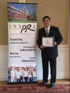 Mundelein High School Assistant Principal James Ongtengco received a Distinguished Service Award from the Illinois Chapter of the National School Public Relations Association.