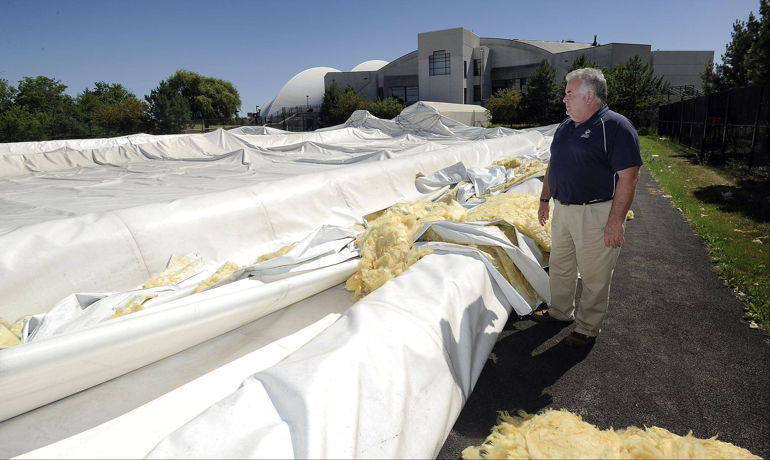 Bob O�Brien, the Hanover Park Park District superintendent of parks, surveys the inflatable tennis dome after it collapsed in June 2012. District officials recently agreed to issue $500,000 in bonds for a replacement dome.