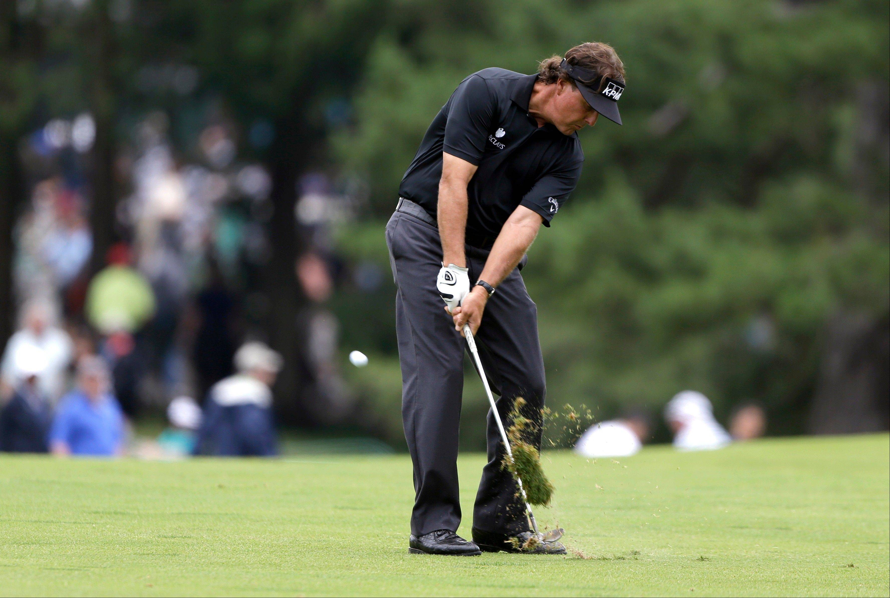 Phil Mickelson hits down the first fairway Thursday during the first round of the U.S. Open at Merion Golf Club in Ardmore, Pa.