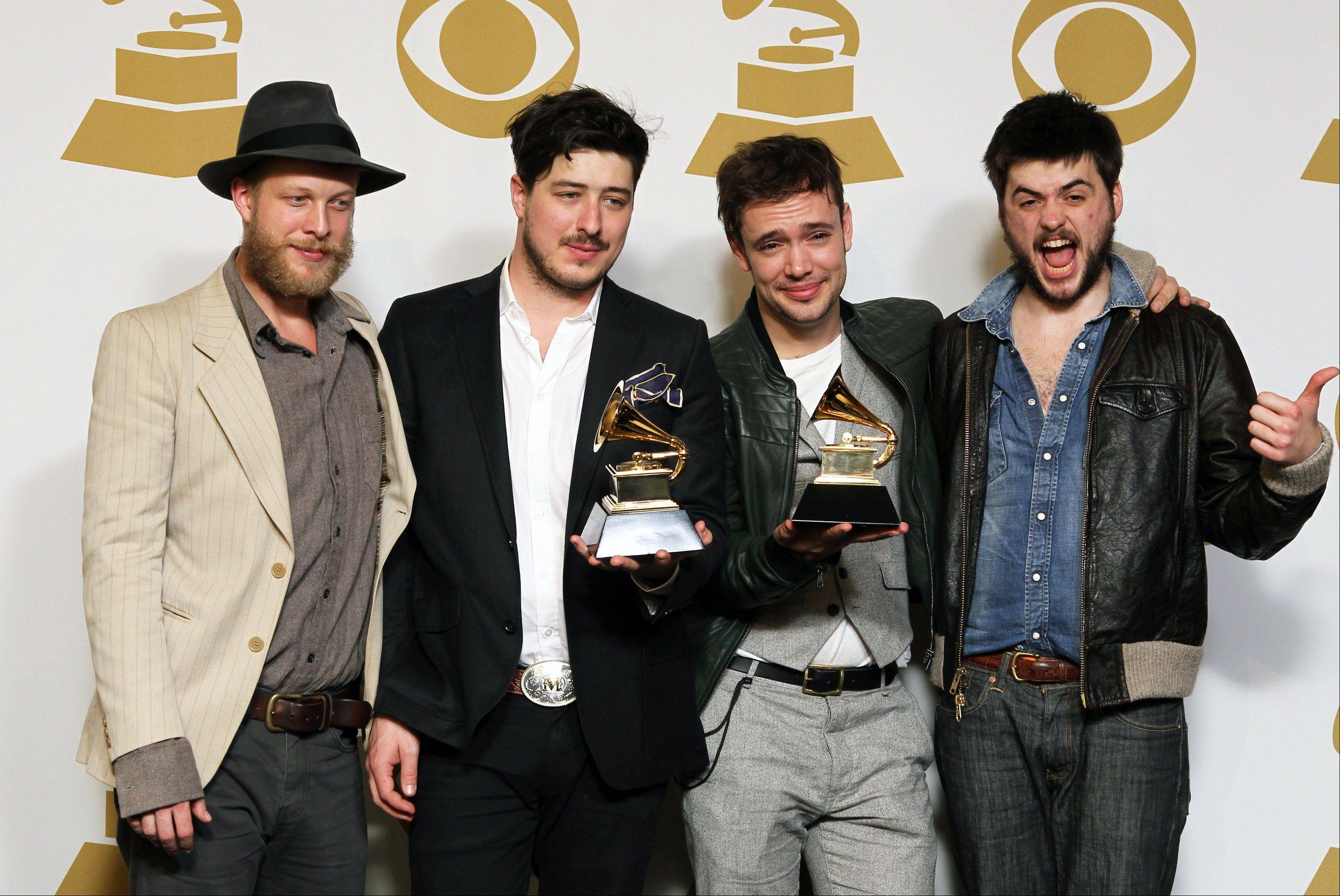 The musical group Mumford & Sons, from left, Ted Dwane, Marcus Mumford, Ben Lovett and Winston Marshall, at the 55th annual Grammy Awards in Los Angeles. The band on Thursday announced it has canceled its headlining performance at Bonnaroo Music & Arts Festival in Tennessee. The decision comes after Dwane received treatment this week for a blood clot on his brain.